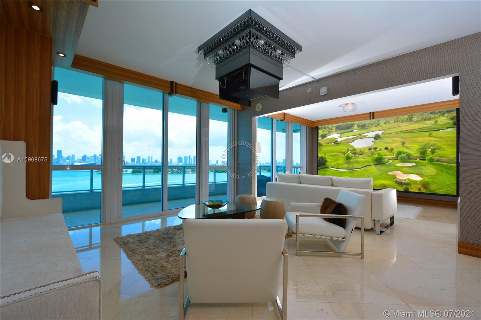 This pristine residence will captivate you with its unobstructed, sweeping water and skyline views and oversized balcony .Top-of-the-line SubZero and Gaggenau  appliances and modern finishes such as Luxor marble  floors throughout, 9'ceilings, Crestron  smart home technology including 140 screen /projector . A generous split floor plan provides plenty of natural light, each bedroom has balcony access and water views, bathrooms are outfitted with spa/steam  room  fixtures. With no luxury compromised, Bentley bay  residents can enjoy amenities including a vanishing-edge pool deck, jacuzzis ,resort-style poolside service and a state-of-the-art fitness facility and spa, 24-hr concierge.West Avenue  offering many Restaurant and soon a park will be open in front
