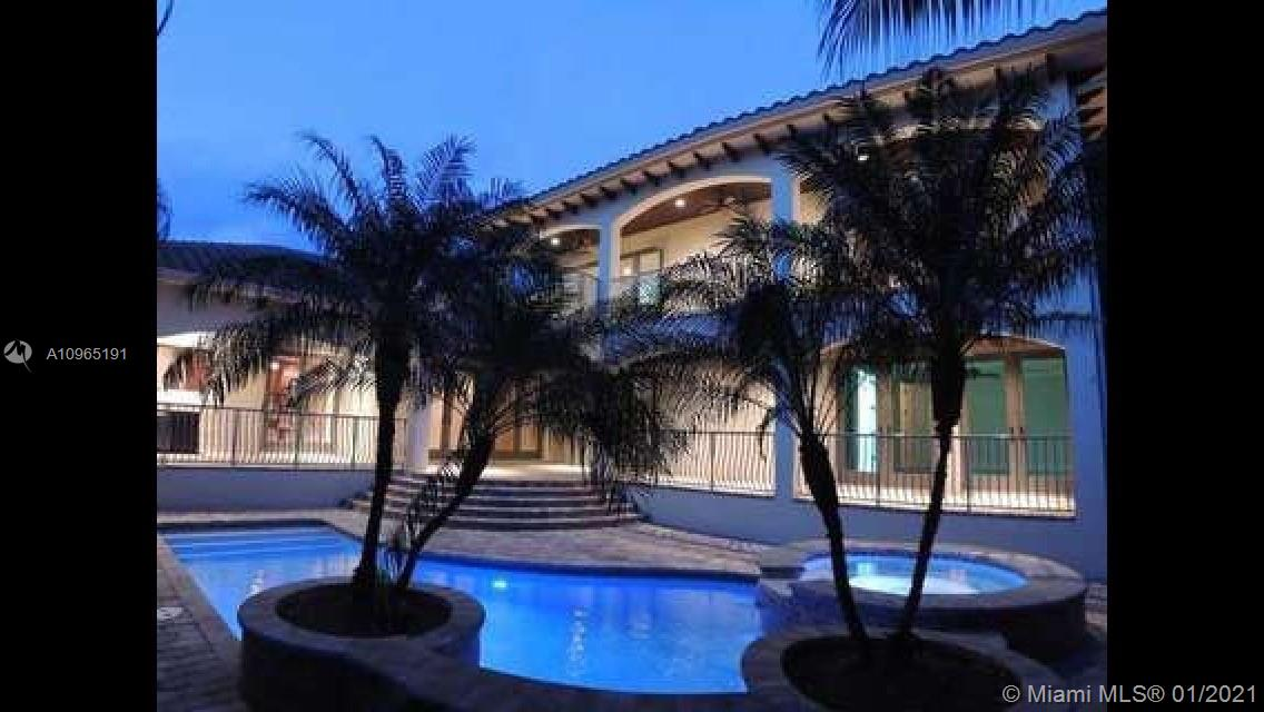 Located on special South Side of Bay Harbor Island's. This is a stately residence with great floor plan. Option for the primary suite to be upstairs or down stairs, both overlooking heated pool/jacuzzi & grand patio area with fully  equipped summer kitchen & covered terrace. For those looking to escape and find a private oasis with outdoor space...this is it. All rooms lead to outdoor entertainment areas. If you choose to spend your time inside...plenty of options: living room with built-in bar; kitchen with gathering area; or, relaxation in expansive family room. Other features include high ceilings, natural gas, 2 car garage, security system, surround sound, hurricane impact windows. Located in A+ school district, blocks from beach, fabulous restaurants & glamorous shops.