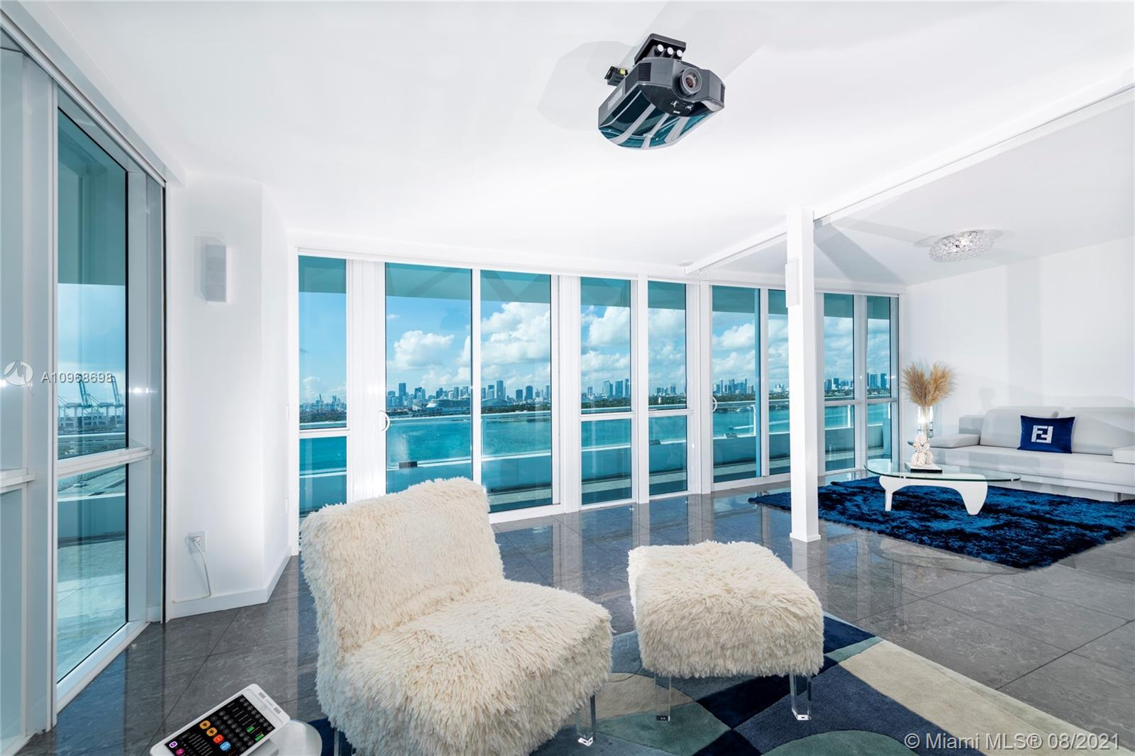 This open floor plan house in the sky located in the heart of south beach  offers panoramic 120° wraparound views of the ocean, Miami skyline at the prestigious Bentley bay residences . This one-of-a-kind  unit boasts floor-to-ceiling windows, 9 'ceilings, state-of-the-art Crestron controlled audio & visual/lighting & shade system & 160' screen /projector . Gourmet chef's kitchen is complete with top-of-the-line Gaggenau  & Sub-Zero appliances.Huge wrap around Corner balconies over 1200 sqft Direct water views/no obstruction Marina downstairs/concierge . Your home and your boat in the same spot..