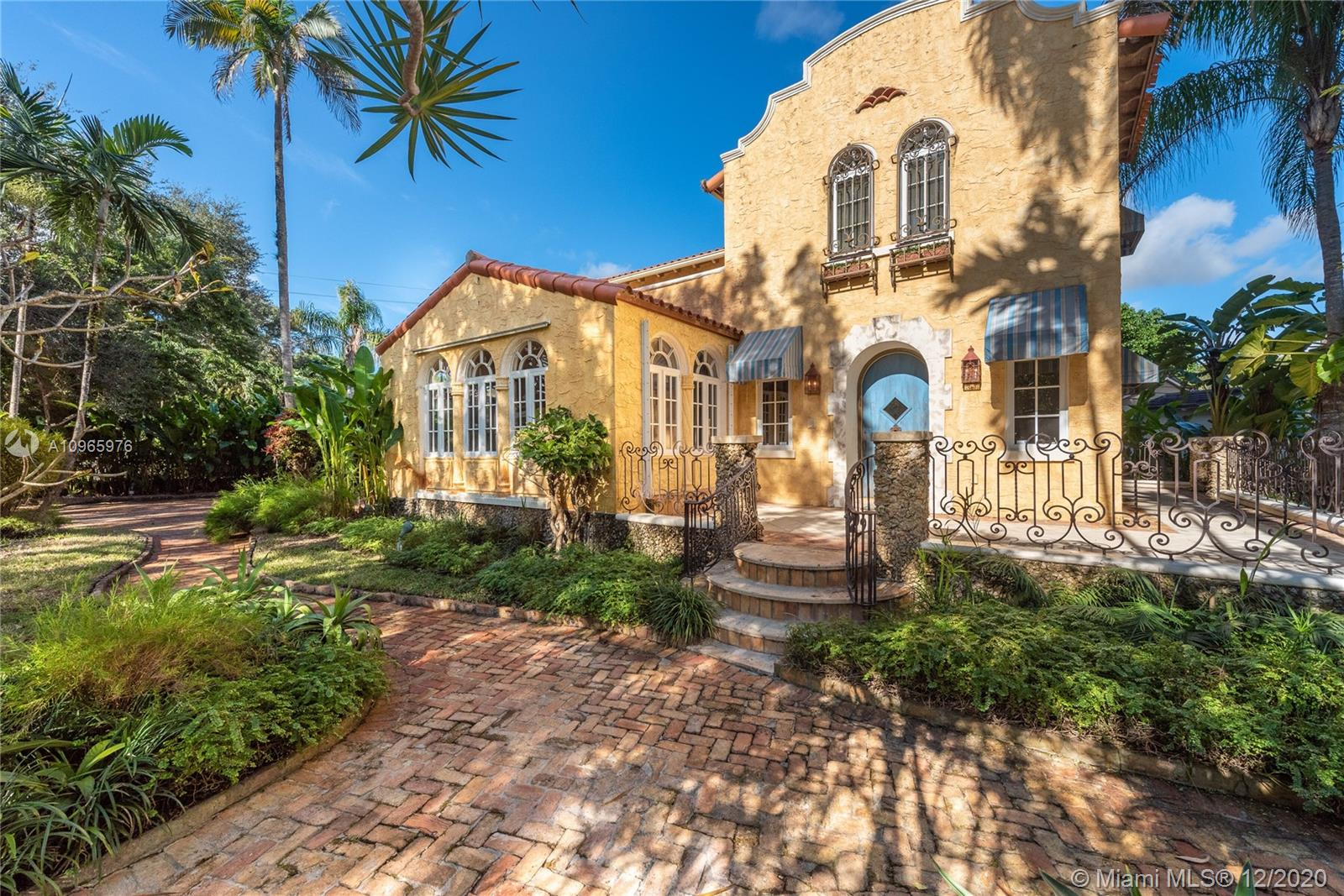 New Listing. Sitting on a large, 11,750 ft. corner lot at Granada and Coral Way, this classic 1925 mansion is ready for a new family. Nestled under huge oaks and palms, this 5 bedroom/4.5 bath (4/3.5 in main house + maid's quarters) home has 3,451 sq. ft. and has charm and character at every turn. Foyer entry, with fireplace spacious living room with Chicago brick floor. The family room has French doors to a terrace and garden. Formal Dining room. The breakfast room and kitchen at the rear with access to a maid's quarters next to the carport. Upstairs find the master suite with three other bedrooms plus an outdoor patio.  FIRM PRICE.  Easy to show