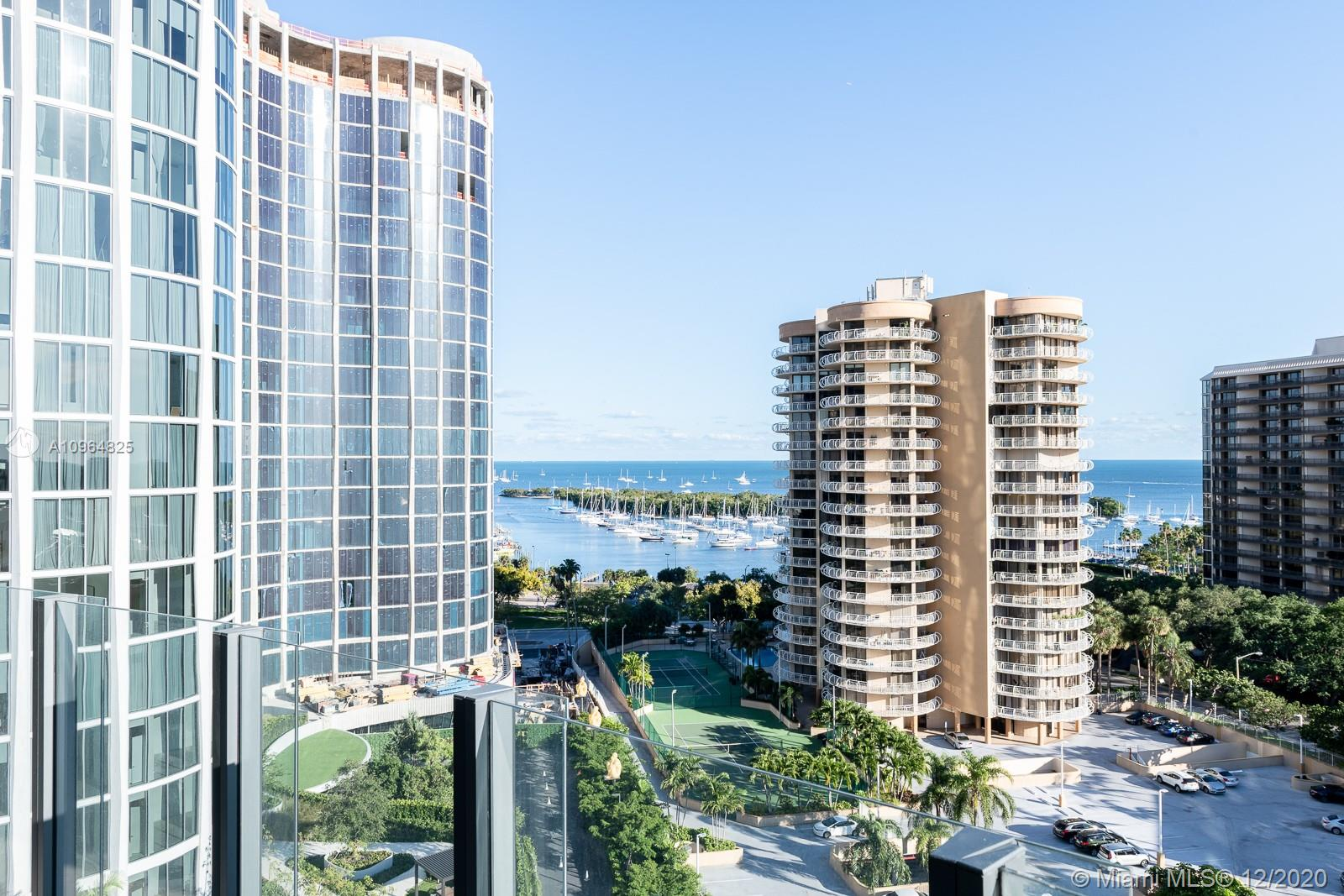 Beautiful corner unit with spacious floor plan with great view of Biscayne Bay and Coconut Grove marina.  Master Bedroom with great master bath, 2 bedrooms with jack and jill bathroom and 1 guest bath. High end appliances Sub-Zero and Wolf with marble countertops. Great amenities, Fitness Center, roof top pool, children's play area, movie theater, 24-hour concierge, sauna and steam rooms. Great location in Coconut Grove a block away from Cocowalk Shopping mall, restaurants, parks, schools and marina.