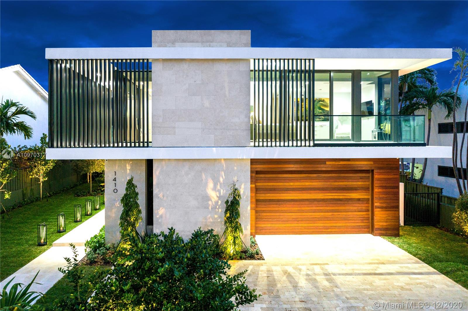Welcome to Villa Nova: a Miami Beach waterfront masterpiece built with the utmost quality of construction and finishes. The 6 bedroom, 7 bath home sits on a 11,250 sq ft lot with 75 ft of prime water frontage and unparalleled views. Its tropical modern architecture is complemented by a facade extensively clad in limestone, aluminum louvers and garage in ipe wood. All exterior flooring is paved in travertine. Elegant interior boasts white oak floors, a Boffi XILA kitchen in walnut and bathrooms, all finished in limestone, also by Boffi. A concrete floating micro-cement coated staircase and Venetian plastered walls make this Villa a one-of-a-kind piece of art. Carefully created to promote healthy living, from the heated salt water pool to the home gym. Luxury and smart technology throughout.