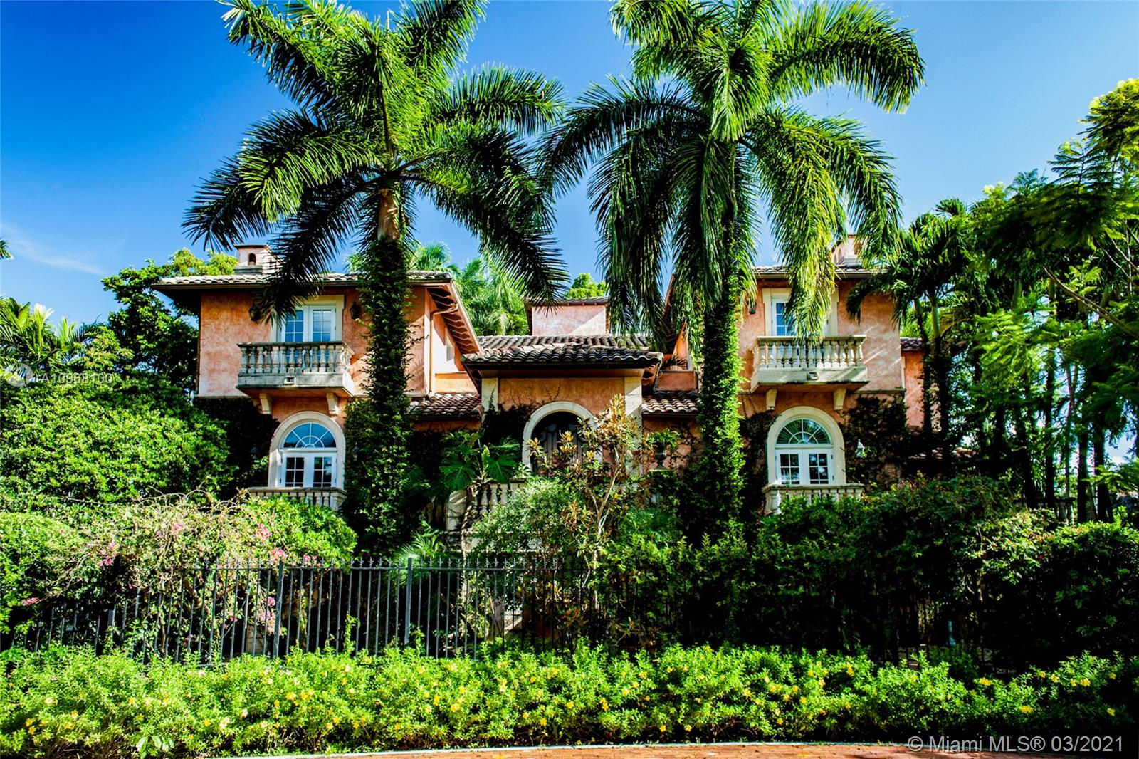 """Located in one of Miami's most historic and charming villages, nestled amongst the canopy of the native trees lies Coconut Grove's best-kept treasure, """"The Anchorage."""" One of only five rarely available homes which sits behind a 24-hour guard-gated enclave. Inspired by the stately villas of Tuscany, this residence exemplifies grandeur at its finest with a European courtyard leading to an al-fresco patio - perfect for entertaining. This 6,234sq.ft. five-bedroom, five-bath estate features a Chef's kitchen, coffered ceilings, fireplace, elevator, 4-car garage, two powder rooms, and pool. This home is just steps away from the pristine waters of Biscayne Bay and a short walk to the heart of Coconut Grove."""
