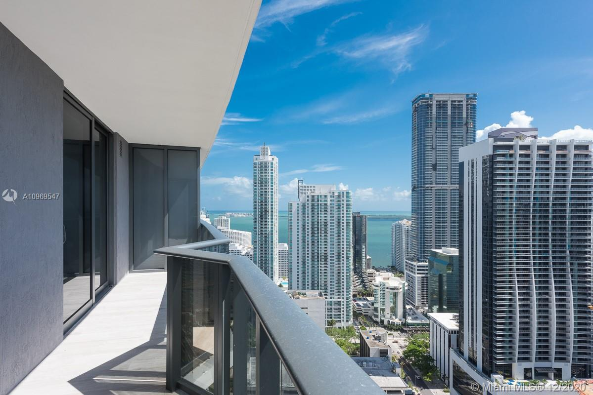 Beautiful and spacious unit in Brickell Heights East Tower with great layout (966 Sqft.) One bedroom + 1 den with 2 full baths. Top of the line appliances and finishes. Great unobstructed views overlooking the Bay and Brickell Skyline from it's spacious balcony. All porcelain floors throughout. Blinds/Blackouts and 1 valet parking space. Amenities include: Concierge 24/7, 2 pools (1 rooftop pool), jacuzzi, gym, steam room, sauna, business center, media room, children play-room, theater. Just steps from Mary Brickell Village, great restaurants and Brickell City Centre. 1 valet parking.