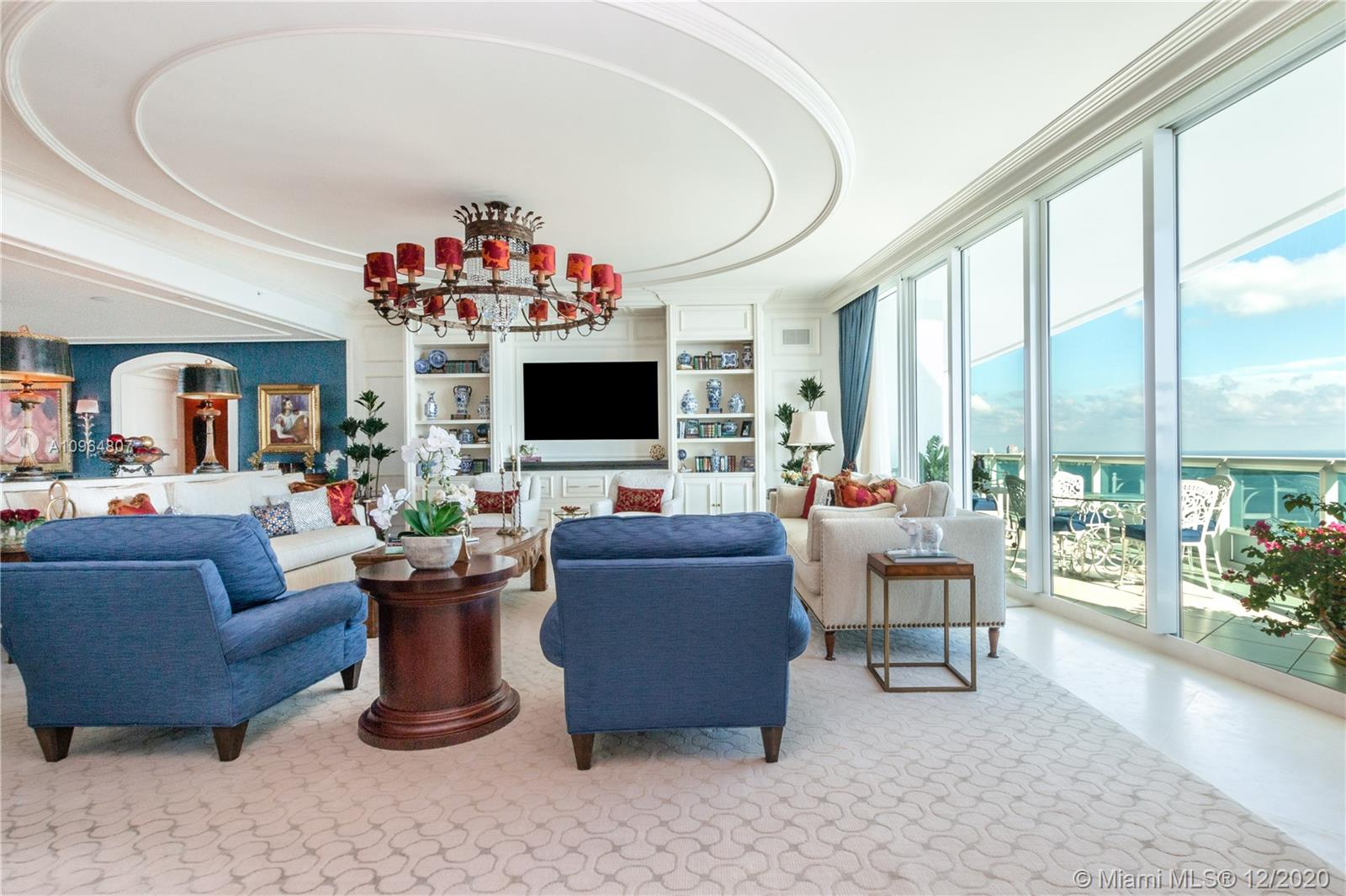 Spectacular flow-through custom designed residence with incredible details throughout. This unit features a private elevator foyer, 4,030 SQFT of living area, French limestone floors, 11 ft ceilings, Italian kitchen with top of the line appliances, surround sound system, expansive terraces with amazing views of the Bay, Miami Skyline and more.