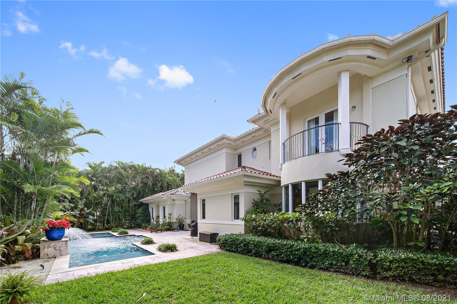 """Exquisite two-story residence on one of the most prestigious streets in Coral Gables.  Elegantly designed and custom-built in 2011 with sophisticated finishes throughout. This 5 beds/6 baths pool home caters to all discerning tastes.  The interior features an extraordinary gourmet kitchen with high end dacor appliances, distinctive walk-in wine cellar, deluxe master suite with spacious sitting room and loft, all bedrooms en-suite, specially commissioned Brazilian wood moldings and artisan handcrafted twisted iron railings, inviting living space with striking details that satisfies all the senses.  You'll love the lush manicured yard complete with paved patio and sparkling pool perfect for entertaining.  Classically styled to be the perfect representation of life in """"The City Beautiful"""""""