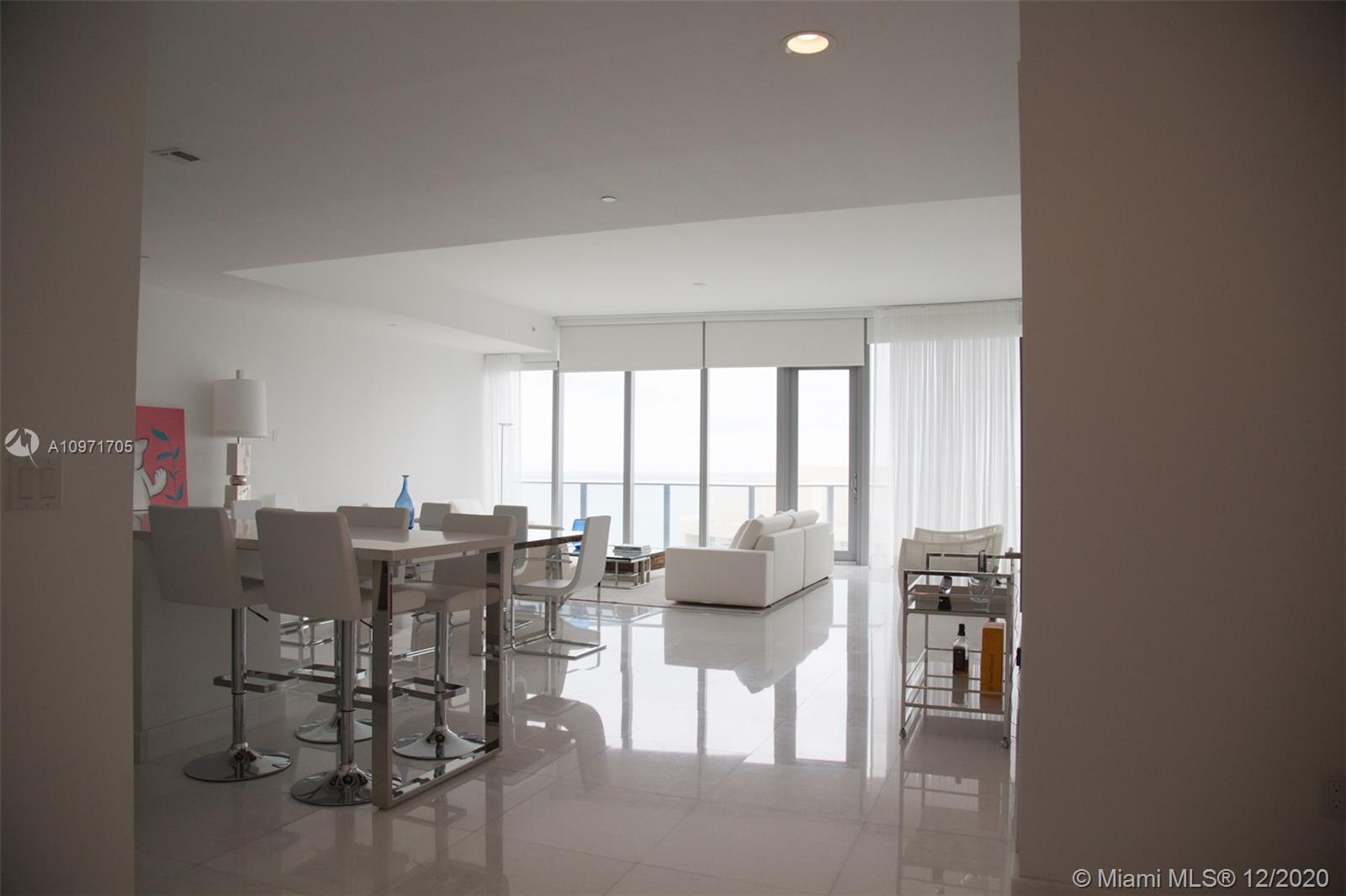 STUNNING!! BREATHTAKING VIEWS OF OCEAN AND INTRACOASTAL FROM THIS BEAUTIFULLY DONE 2 PLUS DEN, 3 FULL BATHROOMS IN PRESTIGIOUS CHATEAU BEACH IN SUNNY ISLES. WHITE MARBLE FLOORS THROUGHOUT. ELECTRIC DRAPES, DESIGNER FURNITURE ALMOST NO USE ALSO FOR SALE. MUST SEE!!