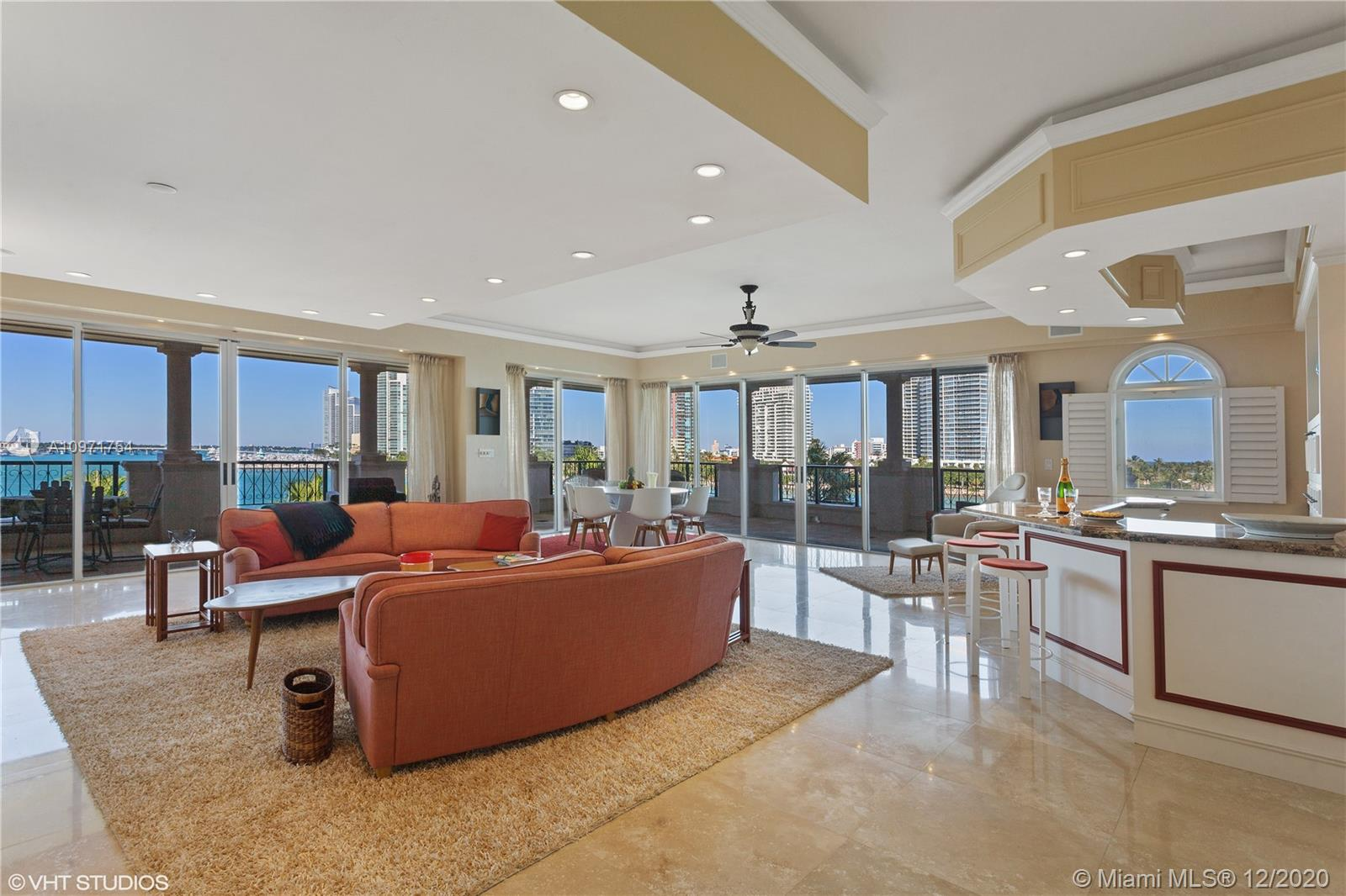 REDUCED! Spectacular Open Corner Villa Del Mare!  With no building immediately adjacent, this Unique corner  offers Rare, Unobstructed, Open Water Views to the North, East, & West - A Sweeping Panorama of Ocean, South Point Park, Miami Beach Marina, Government Cut, & Miami Beach Skyline! Vibrant boat activity includes Majestic Cruise Ships as they Glide By!  Bathed in Natural Sunlight from all directions. This Pristine 3 Bedroom, 3.5 Bath Residence has been skillfully designed & upgraded, including many custom features, built-ins, & wood-work.  Living Room features an Expanded Custom Bar fitted with wine cooler, ice maker, and refrigerator.  Generous Primary Bedroom includes ample sitting area, walk-in closets, private waterfront terrace.  Considered the most Desirable Oceanfront Building.