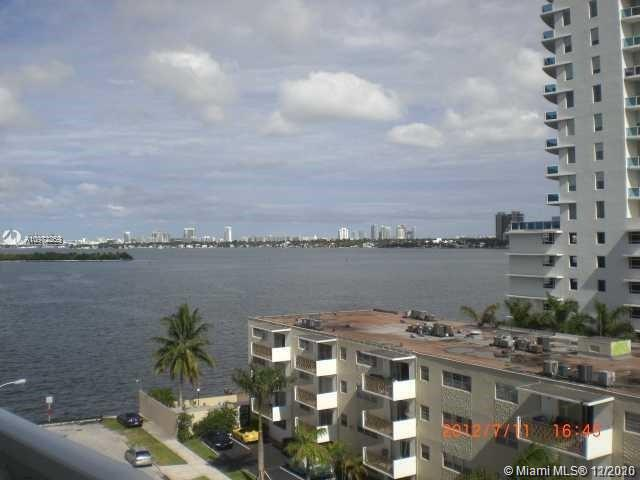 SPECTACULAR BAY VIEW 3BED/2BATH WITH OVERSIZED TERRACE. AMAZING MIAMI BEACH SKYLINES AND BAY VIEWS. MODERN KITCHEN, STAINLESS STEEL APPLIANCES, NEW VINYL  FLOORS, GRANITE COUNTERTOPS - 2 PARKING SPACES - THE BUILDING OFFERS A POOL, GYM, AND SOCIAL ROOM.