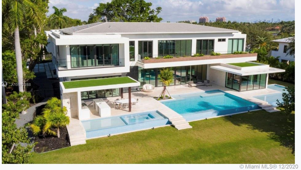 """2018 New Construction built and designed modern Marvel by G3C in conjunction with Lucrecia Lindemann Luxury...Located in the one and only coveted """"Gables Estates"""".  Water view on bot sides of estate.   Boasts 13,000 interior space on a acre plus lot.    6 bd/ 9.5 baths   No detail spared.   For appointment contact listing agent *PRICE IS FIRM*"""