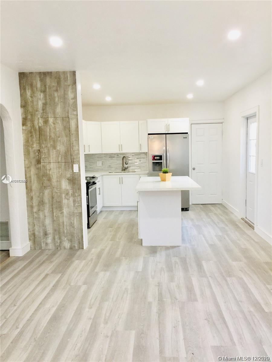 FULLY RENOVATED home in a quiet area in Hollywood few blocks from US1, tall fenced backyard with a build-in shed. Walking distance from school, parks & shops in downtown Hollywood, Wood Floors & Central A.C, Pet are Allow 20 Lb. Max and a $250 deposit Non-refundable Per Pet. There is an adjacent Studio completely separated from the house with its own side entrance. AVAILABLE to show after January 8th.