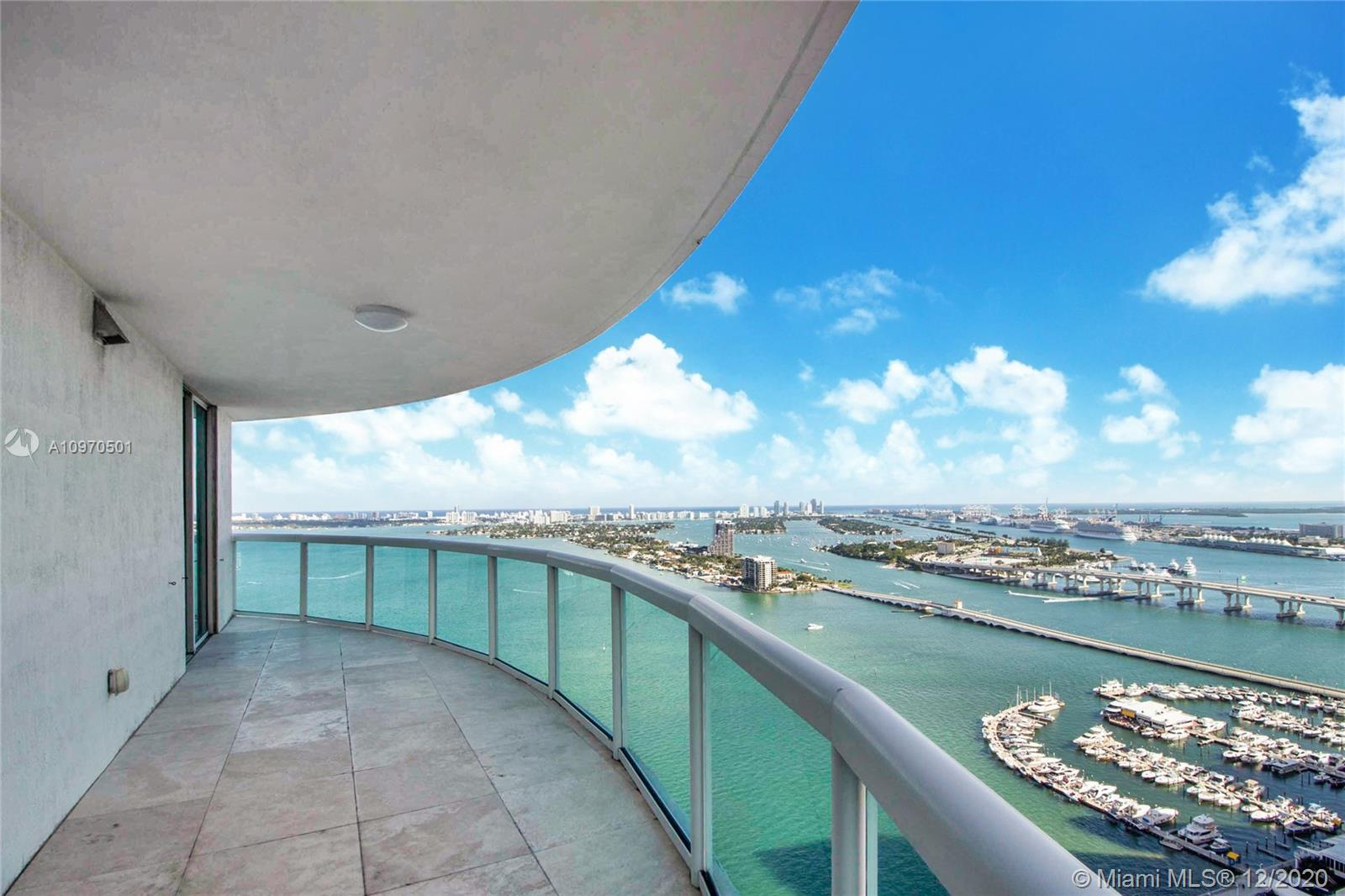 """Enjoy spectacular water views of Biscayne Bay and the ocean from this direct east facing high floor 3bed/3bath 2,189 SF residence in the luxury 1800 Club. With 638 SF of terrace space, this 40th floor """"01"""" line residence personifies Florida indoor/outdoor living. A spacious floor plan with an open kitchen allows for plenty of room to entertain while you enjoy the view. The master features a walk in closet and ensuite bath. The 1800 Club is known for its full service amenities including: valet, doorman, concierge, pool and fitness center attendant, resort style pool deck, and much more.. Walk to Margaret Pace Park. Only a short drive to Wynwood, Midtown restaurants Design District shops, and Miami nightlife."""