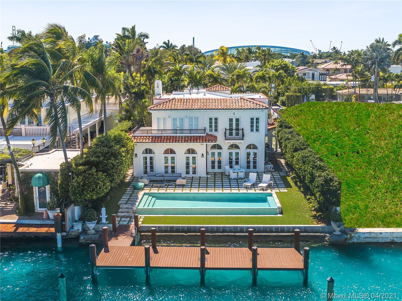 OLD WORLD ELEGANCE WITH A MODERN TWIST ON THE WIDE BAY IN HIBISCUS ISLAND! Fully Renovated 5 bed/5.5 bath Med-Mod home w/ infinity pool Overlooking 40ft Ipe Wood Dock + 60 Ft of Waterfront w/ Open Bay Views. 4,619 SQFT Living Space on a 10,500 SQFT lot. Marble Floors w/ In-laid Design in Formal Living Room; Coffered Ceilings in Family Room Leads to Dining room. Wide-Plank Walnut Floors on 2nd Floor. Custom Chef's Kitchen in White Lacquer Clive Christian Cabinetry w/ La Cornue Gas Range & Stainless-Steel Wolf Appliances; Furnished by Artefacto & Kemble Interiors. 3 Bedrooms in the Main House + 2 Bedrooms in Two-Story Guest House w/ living room, dining area & kitchenette. Landscaped Interior Courtyard Unites the 2 Wings of the Home. Polished Nickel Plumbing. Savant Home Automation System.