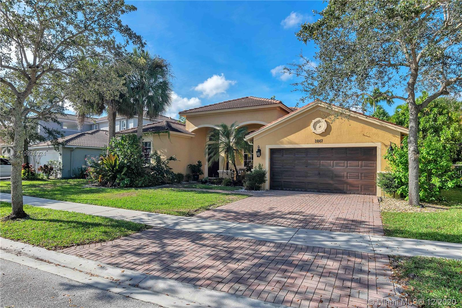 Gorgeous 4 bed/3 bath, with pool and water view in sought after Isles at Weston, zoned for Falcon Cove and Cypress Bay High! This amazing 1 story home shows like a model: neutral colors, convenient 3 way split floor layout, very spacious dining room and large living room overlooking the pool, with luscious landscaping, and huge covered patio area, ideal for relaxing after a long day. High ceilings, bright and airy floor plan, kitchen overlooking the breakfast nook and a wonderful family room, great for entertaining. Large Master Bedroom with direct access to the pool area, Junior suite with its own full bathroom, also used as cabana bath, perfect for guests, office or in-laws. 2 more bedrooms share the 3rd bath. Fantastic amenities including club house, gym, tot lot and more! Call today!