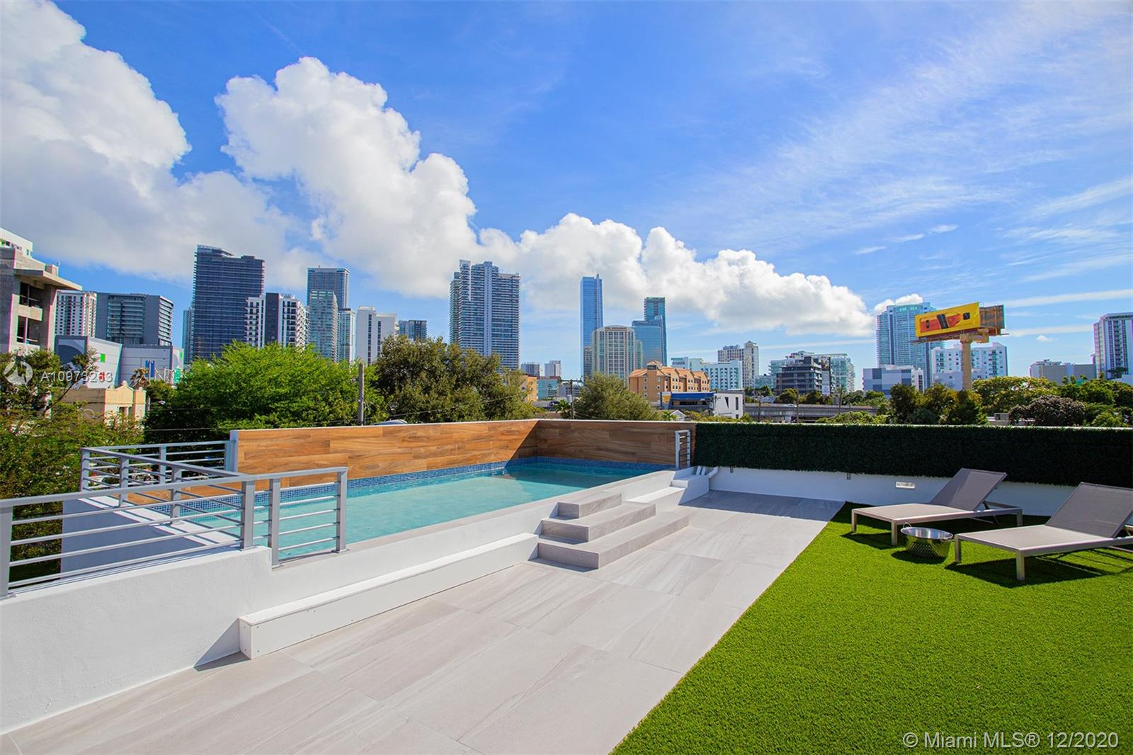You will fall in love with this luxury 3 bedroom, 4 bathroom home. The new construction features a rooftop pool and deck overlooking the amazing Miami skyline, a 10 person movie theater,  a one car garage, a luxury gourmet kitchen, and a tropical-modern design throughout!  The amazing master bedroom contains his/her oversized closets & the bathroom of your dreams! All of this situated in a central, friendly neighborhood with outstanding schools and restaurants.