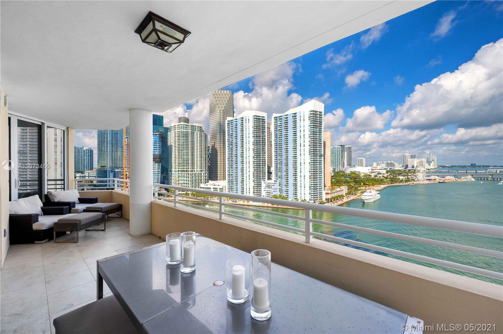 Private corner residence with Exuberant direct views of the Bay, Miami River and Miami's Skyline!  With two generous sized balconies to enjoy from the privacy of your own home.