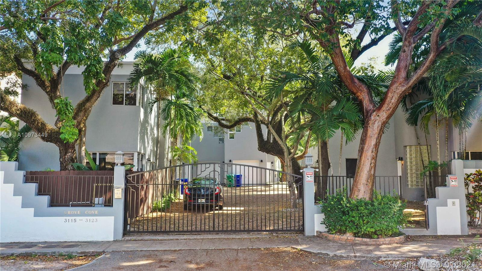 This Beautiful Townhouse is situated in a private pod of town-homes in lush garden under a majestic canopy of native trees with enclosed garage parking. The master bedroom/bathroom with walk-in closet and the 2 junior bedrooms/2 bathroom are in a  the second floor overlooking  the peaceful fenced garden. The 1st floor includes  1 car garage. The main entrance connects to the open kitchen, guest bathroom and a high ceiling dining and living room, this social area is wrapped in south facing glass doors opening to the enchanting garden patio of oaks and palms that gives the necessary energy for serenity to feel home. The property is located in trendy and historic North Coconut Grove, walking distance to the park,dining and shopping, minutes to Coral Gables,Downtown, Brickell and the Beaches.