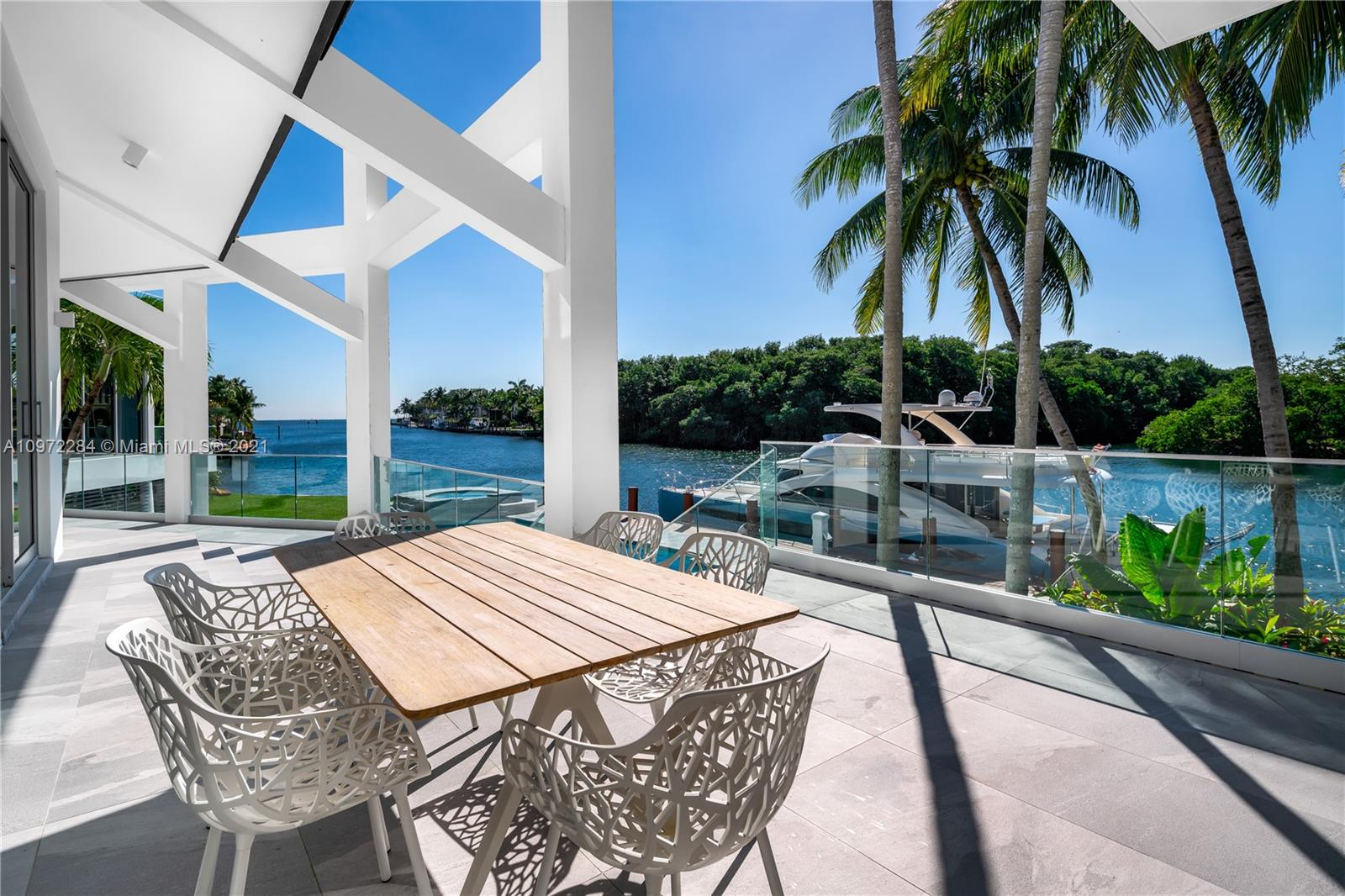 Completely rebuilt with custom chic modern design by Carmen Alcaraz Gomes of CG1 Design. This waterfront home is nestled on a quiet cul-de-sac in the guard-gated community, Sunrise Harbour. Perfectly situated on a SE corner, with 189 ft waterfrontage on Coral Gables Waterway, showcasing unobstructed bay views. New dock and deep water easily accommodate a large yacht. Multiple terraces overlook the pool and spa creating intimate entertaining spaces. Interior features include open floor plan, double height ceiling, custom glass encased wine cellar, 3 car garage and elevator. Master suite features his/hers walk-in closets, private balcony, separate shower and jacuzzi for two. Kitchen with Miele appliances, chef's island, and breakfast nook. Close to parks, shops, eateries, and A+ schools.