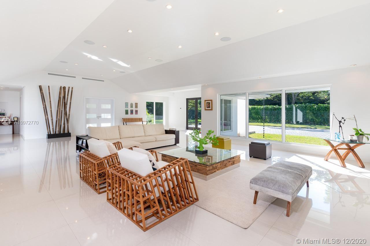 REBUILT in 2015, this One-Story contemporary Estate located in the heart of Pinecrest. This home offers 6 en suite bedrooms with built in closets plus a den/office space. Private master suite, featuring luxurious bathroom retreat and built-in closets. Expansive open floor plan living spaces surrounded by large impact picture windows & doors offering plenty of natural light and flow through views. Modern clean finishes all throughout. Large great room with volume ceilings opens to a beautiful family room and large kitchen with wood cabinetry and natural stone island, Thermador appliances and gas range – perfect for entertaining. The exterior includes covered terrace w/ outdoor kitchen, large pool and spa.  Fully automated Smart home plus generator.Full impact windows/doors & new roof (2015)