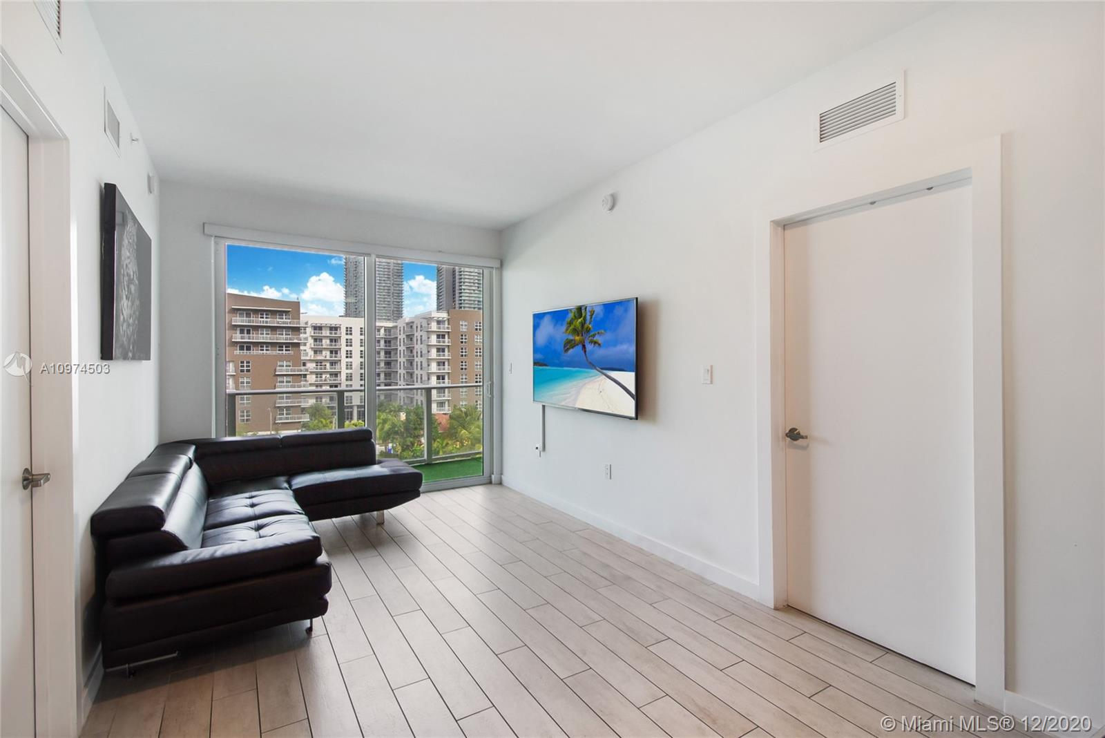 Boutique style building minutes from Downtown, Brickell, Midtown, Design District and much more! Beautiful 2/2 unit in the popular Edgewater neighborhood. Unit features porcelain wood style floors, floor to ceiling impact windows and sliding doors and 9 foot ceilings. Residents of 26 Edgewater can enjoy amenities such as rooftop pool, lounge and sun deck, fitness center and party room