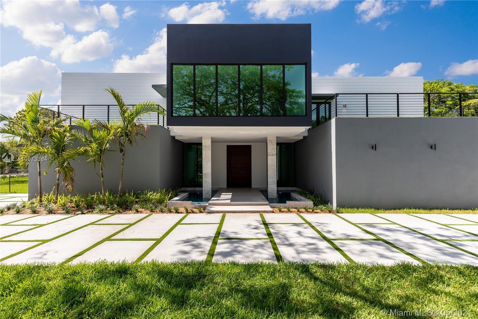 Modern Masterpiece designed by ECO Modern Custom Homes. This 2-story is being constructed in a cozy neighborhood of Pinecrest set to be completed in March 2021. Walk through a solid wood pivot door into an open + airy living area with 20-FT ceilings and porcelain Castellon flooring from Spain. Meticulously built 8,803SF featuring 7BR, 7.5BA, 2 separate car garages, media room, wine cellar, Pedini Kitchen, safe room + office. Entertain guests on this 31,798SF lot with a pool, lush landscape around the perimeter. Equipped smart home all controlled via app from smartphone.