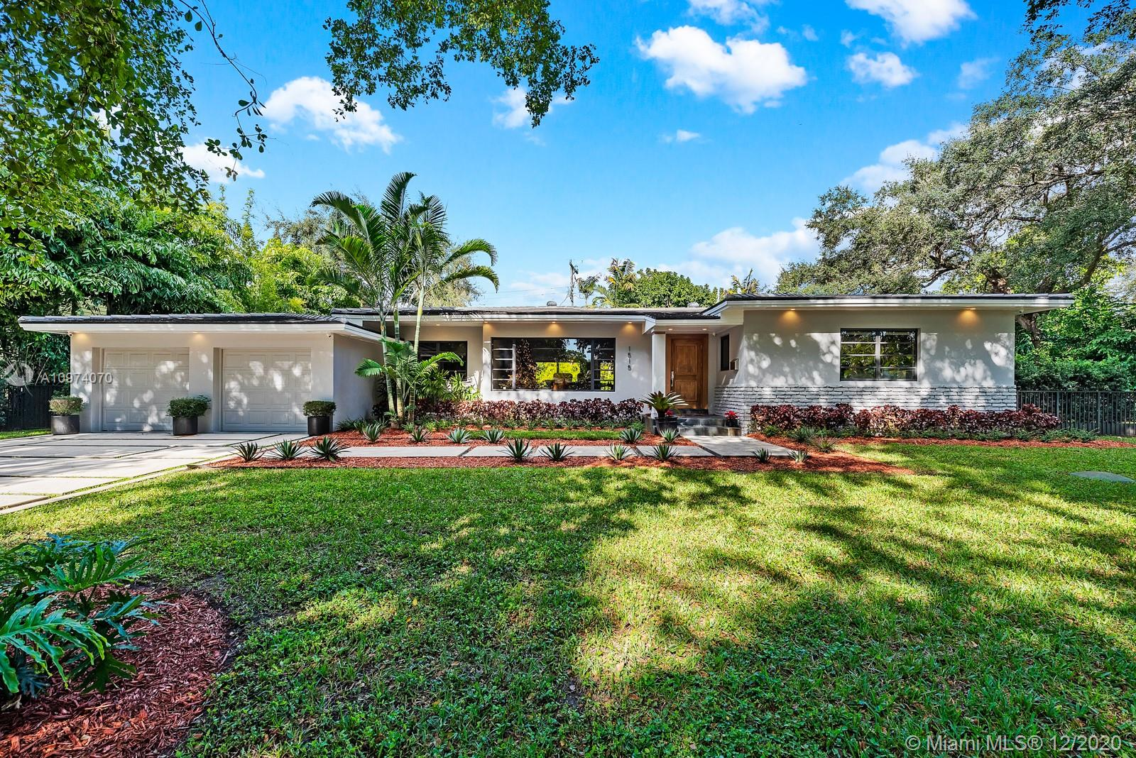 Completely remodeled 3 bedroom, 2 bath homes in sought out Coral Gables. Beautiful park right across the street. Filled with light, this open floor plan home features hardwood floors, a custom chandelier in the dining area, custom wood cabinetry, Thermador Gas range, stainless steel appliances, oversized island with quartz countertops. Bathrooms are completely updated with marble floors. Master featuring his/hers sink, steam feature in the shower with a door to the pool, jets and built in rain shower head. Indoor laundry room with sink, second dishwasher. Smart home with indoor/outdoor speakers, built-in alarm system, exterior cameras. New exterior paint, landscaping, and newer roof and new AC unit. Well water for irrigation and auto-sprinklers. Additional lot is included with the home.