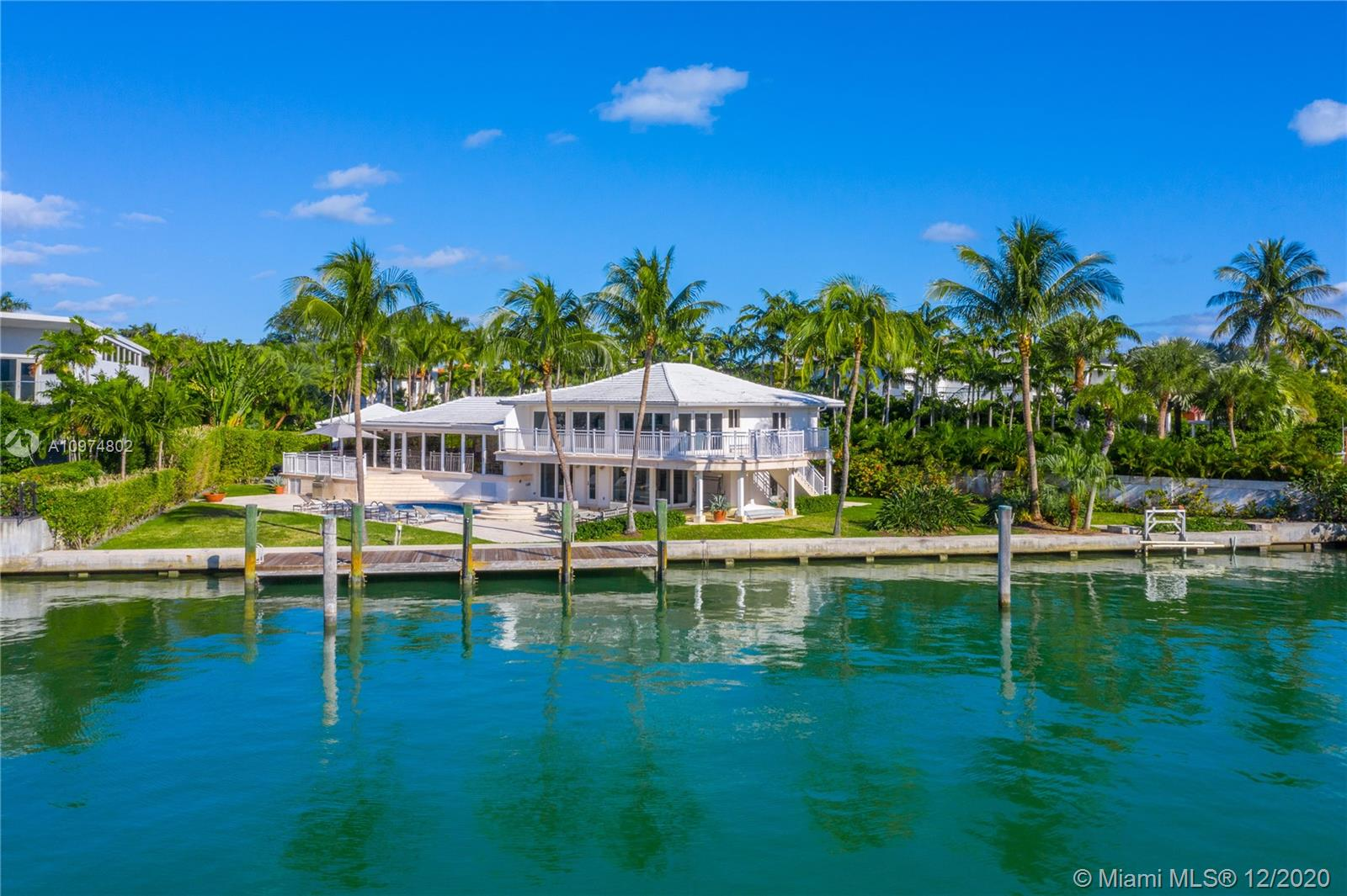 A true boater's paradise with 165 feet on the water on gorgeous Hurricane Harbor.  A Florida waterfront home with fantastic and gorgeous open views, stunning sunsets and southern exposure which makes this residence very bright and light.  Charming, remodeled and updated, perfect for a family to enjoy offering 6 bedrooms, 6.5 baths, spacious living-dining room area, great kitchen, a splendid pool and patio area, wonderful terraces throughout and plenty of parking area.  Enjoy island living at its best …in this private and gated hideaway.