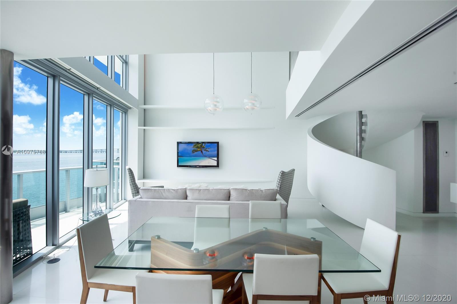 Take in sweeping Bay views from every angle of this unique, tri-level unit at JADE BRICKELL. The 2/2.5 Bay Loft sets itself apart with a complete, custom renovation defined by clean lines and minimalist sophistication. Upgrades include custom cabinetry and closets, Miele and Sub-Zero appliances, and a stunning architectural staircase. First level includes living and dining spaces, second level features Master suite and den, and third level opens to additional bedroom/living space with a large, secondary balcony. Located in the most coveted spot on Brickell Bay Drive, the Jade offers unfettered access to cosmopolitan life on Brickell, while providing a quiet haven when the sun sets. You can count on unobstructed Bay views forever. A Very Special Home.