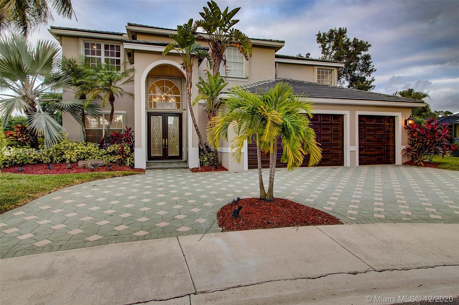 Absolutely gorgeous home located in one of Weston's most desirable neighborhoods, The Landings. This stunning home is completely remodeled and includes an exquisite sunroom, beautiful screened in pool and summer kitchen overlooking the lake. 5 bedrooms, 4 bathrooms and 3 car garage. True South Florida Living at its best.