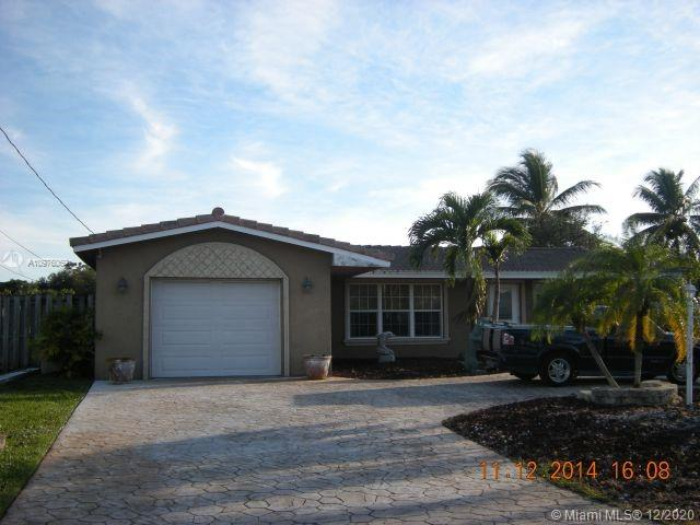 TRANQUIL WATERFRONT OCEAN ACCESS HOME with INDOOR-OUTDOOR FLORIDA LIFESTYLE LIVING W/ BREATHTAKING SUNSET VIEWS ON QUIET CUL DE SAC STREET!! Tropical landscaping greets you at your circular driveway. Large patio & deck area perfect for entertaining poolside, watching the sunset from your porch in your very own hot tub overlooking the water or jumping on your boat with the family for a full day of enjoying the South Florida Waterways! Split plan, tool shed, fenced yard, lush landscaping & fruit trees. PRIVATE DOCK FOR YOUR BOAT & WATER TOYS. SHORT RIDE TO OCEAN. The home can be a primary home or can be a fantastic airbnb vacation rental. Don't let this home get away!