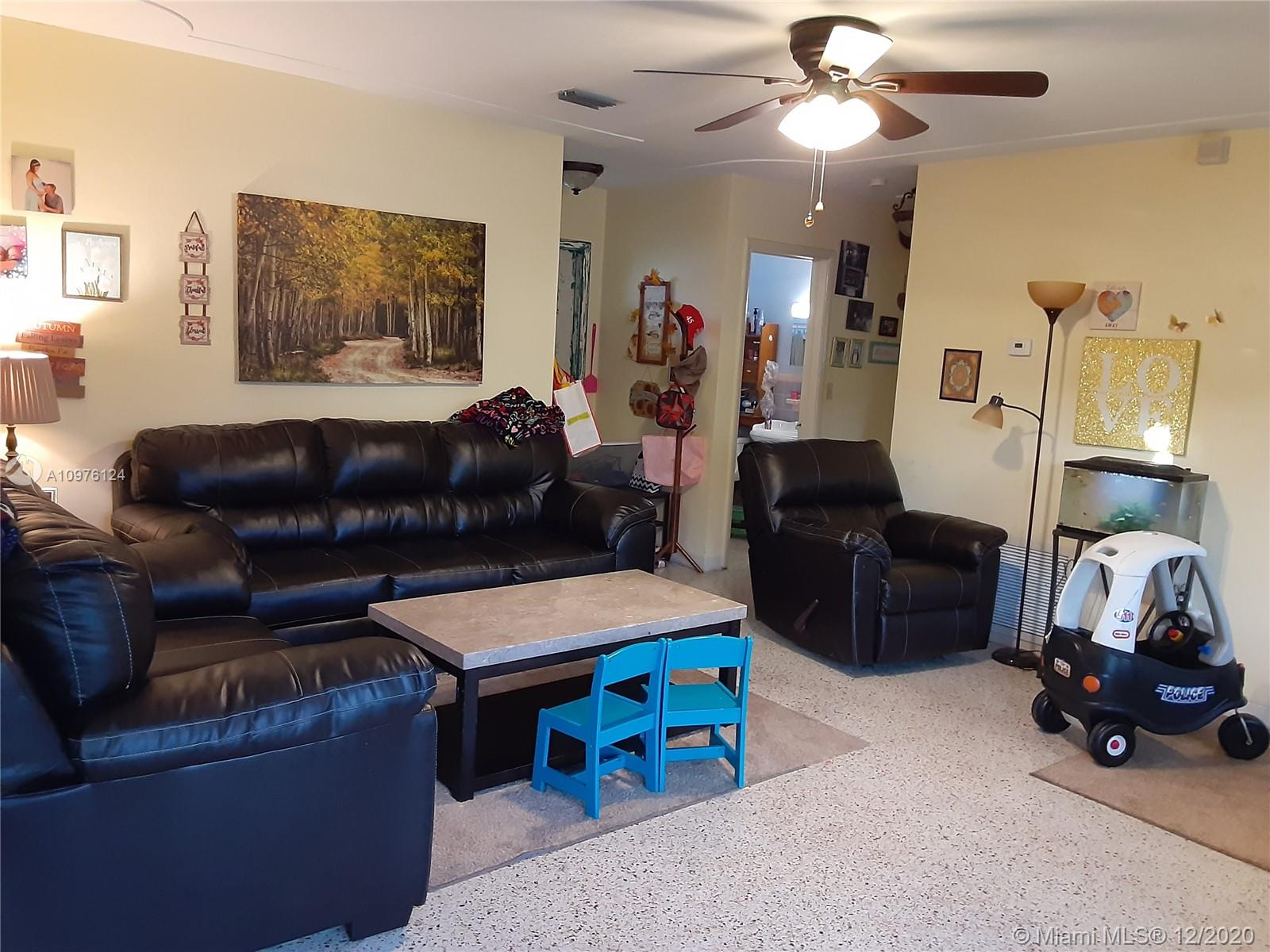 Metal roof,  new a/c, large yard, terrazzo floors, large shed 3/2 includes 1 bedrm & 1 bath with side entrance.