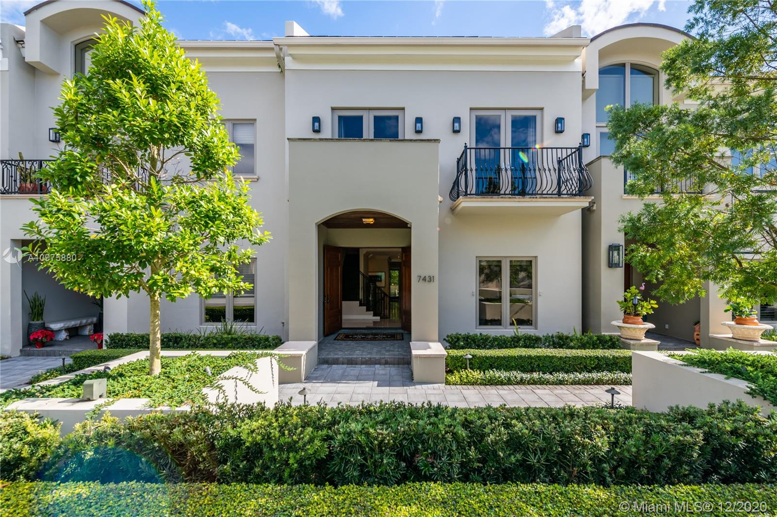 Townhomes at Oak Lane. Elegant yet low-key luxury defines life in this gated, camera-monitored South Miami community. The 3-story residence accented w/French doors + marble & wood floors brims over w/indulgent amenities. Pamper yourself in a spa-like master bath w/soaking tub. Prepare fabulous meals in a top-of-the-line gourmet kitchen. Host special evenings in formal living & dining rooms. Hang out w/family & friends in the kitchen-adjacent family room that opens to a large private patio w/a built-in alfresco kitchen. Set up an office, gym, playroom, she-shed, or man-cave in a large basement-level room w/direct access via stairs, elevator & garage. Hurricane defense features incl. impact windows/doors, Kevlar screens, generator. 3BD/3.5BA/2,678 Adj. SF. 4 Garage spaces. Extensive storage.