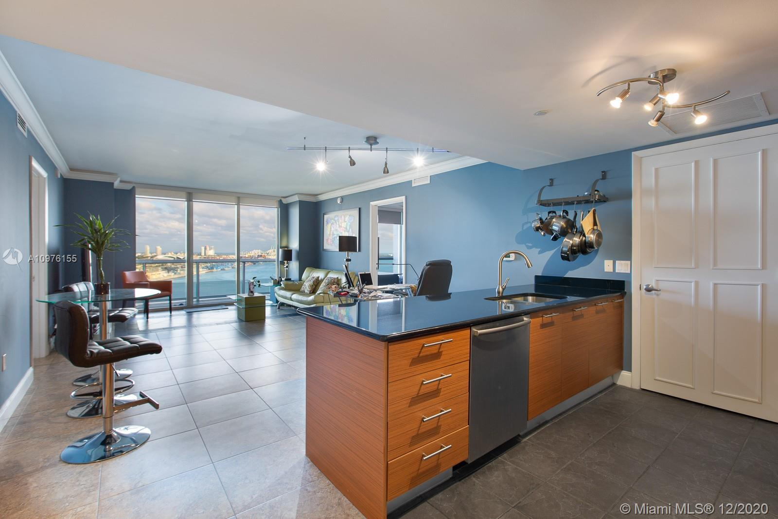 Enjoy beautiful city and bay views from your balcony at 50 Biscayne. This large 2/2 bedroom has an open kitchen with stainless steel appliances, W/D in the apt, comes with one assigned parking space and building offers valet service as well. 50 Biscayne Condominium is a unique residential tower designed by Sieger Suarez with interiors by David Rockwell. The building offers a secured lobby with 24hr front desk service, resort amenities including a 3 story lobby, club room with kitchen and billiards, 10th floor pool with cabanas/daybeds, 2 level fitness center and spa center offering gym, mediation and Pilates room. Walking distance to American Airlines Arena, Bayside, Brickell CIty Centre, restaurants and shopping!