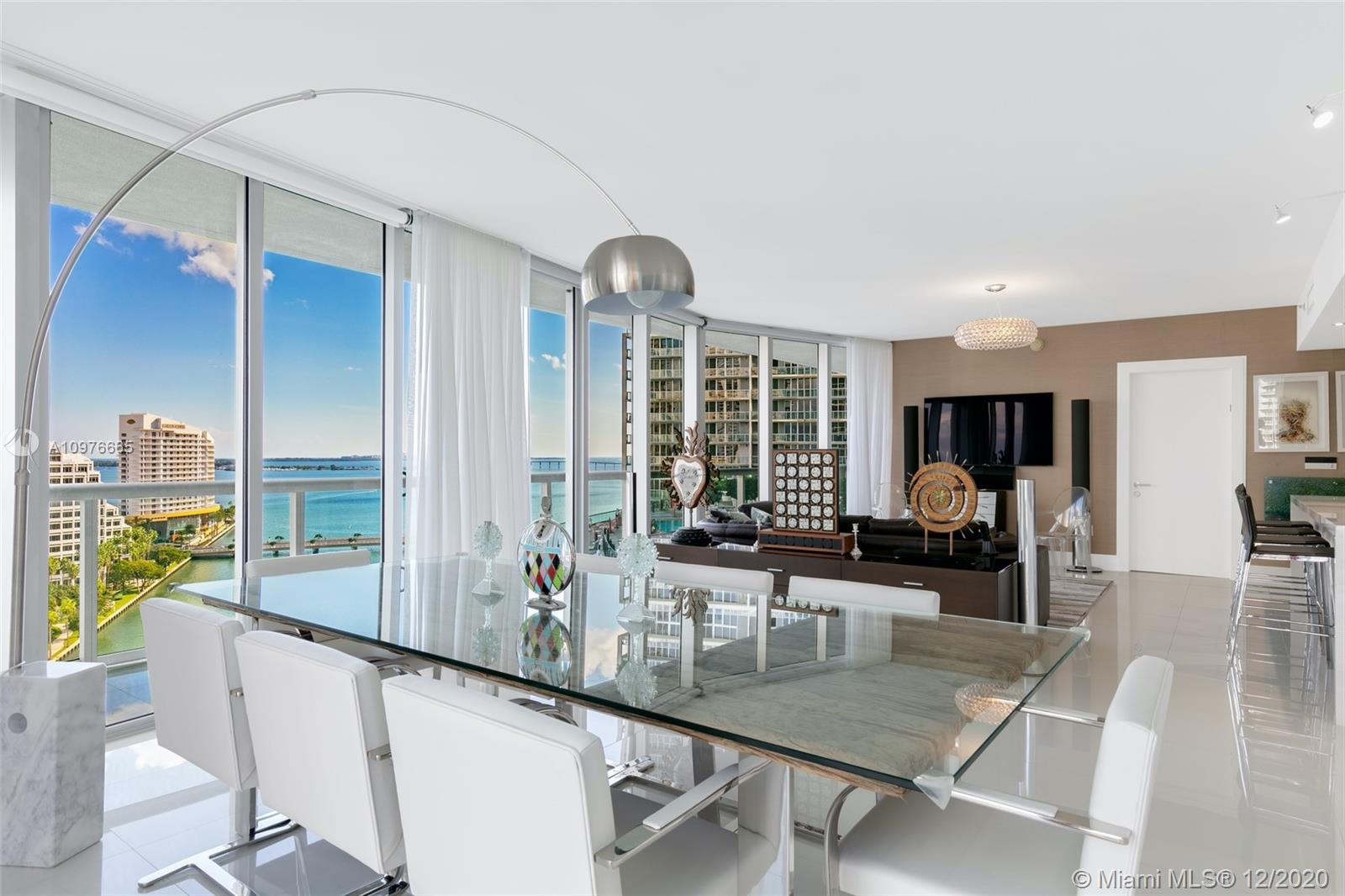 One-of-a-kind, impeccably maintained, highly upgraded 3bed/2.5bath in Icon Brickell. One of the best 3-bed layouts in the Brickell marketplace w/ bay views from all living & bedrooms. Just renovated luxurious kitchen & stunning Master Bath! White Porcelain floors in living areas & wood in beds, motorized blinds & sheer curtains. Lurtron lighting system, Nest digital thermostat w/ smartphone app, media wall w TV/Bang & Olufson audio system, custom closets, 2nd garage space & furniture can be purchased separately.
