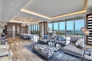 This is the largest condo on one floor in Miami, occupying the entire floor of the North Tower. This 11,000 sq. ft. unit offers a perfectly designed interior by Nick Luaces with 6 bedrooms, 6 bathrooms and 2 powder rooms. Movie theater, library, office and four separate seating areas. State of the art home automation system with Bang & Olufsen. 3000 sq ft master suite with chic dressing room, midnight kitchen, impressive bathroom, gym, massage room, and both wet & dry sauna. Generous terraces surround the condo & are accessible from all public rooms, facilitating entertaining on any scale. Its offered fully furnished including stunning art work. 4 car private garage. A truly one of a kind masterpiece, located in the architectural marvel, Grove at Grand Bay by star architect Bjarke Engels.