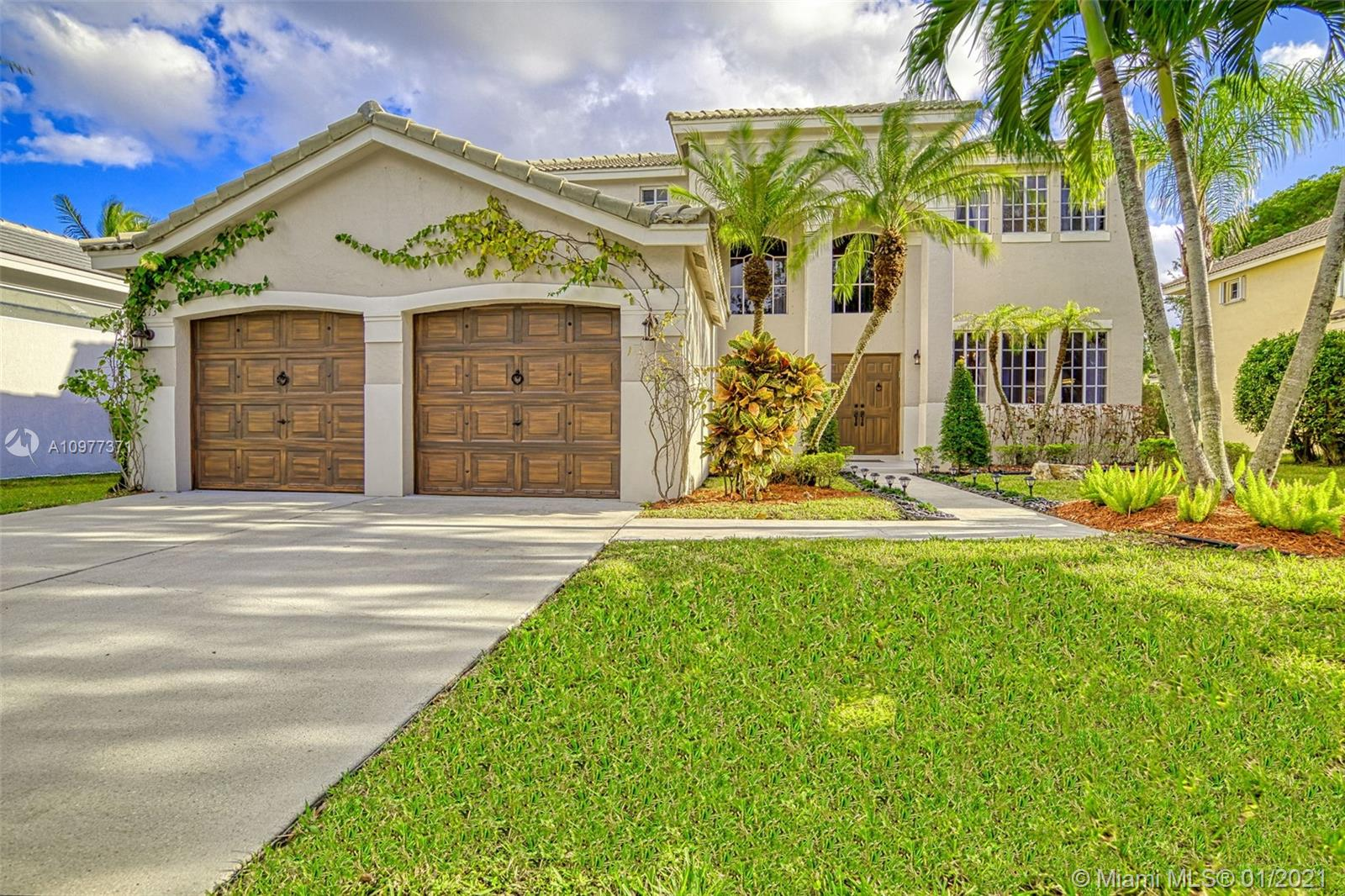 GORGEOUS HOME IN THE UPSCALE CITY OF WESTON! THIS WELL-KEPT HOME HAS 5 BEDROOMS AND 3 FULL BATHROOM, GUEST OR IN-LAW BEDROOM ON THE FIRST FLOOR. SITTING ON A 7,377 LOT, GREAT FOR A BIG FAMILY! COMPLETELY RENOVATED IN 2017. THIS ELEGANT HOME FEATURES SPLIT OPEN FLOOR PLAN IN LIVING AREAS, KITCHEN WITH WOOD CABINETS, GRANITE COUNTER TOPS AND TOP OF THE LINE SS APPLIANCES. DUAL AC SYSTEM WITH ADDED UV LIGHTS THAT STERILIZE, DEODORIZES AND PURIFIES THE AIR. TRAVERTINE AND MARBLE/ONYX BATHS, FRAMELESS SHOWER DOORS WITH MASSAGE SYSTEM IN ALL BATHS. WATER RESISTANCE WOOD-BASE FLOORS THROUGHOUT THE HOUSE AND FAUX WOOD PAINTED GARAGE AND FRONT DOOR. RELAXING GARDEN VIEW,  SURROUNDED BY LOVELY TREES AND WELL MAINTAINED LUSH TROPICAL LANDSCAPE DESIGN. COMM POOL AND RATED A + SCHOOLS, BRING AN OFFER.