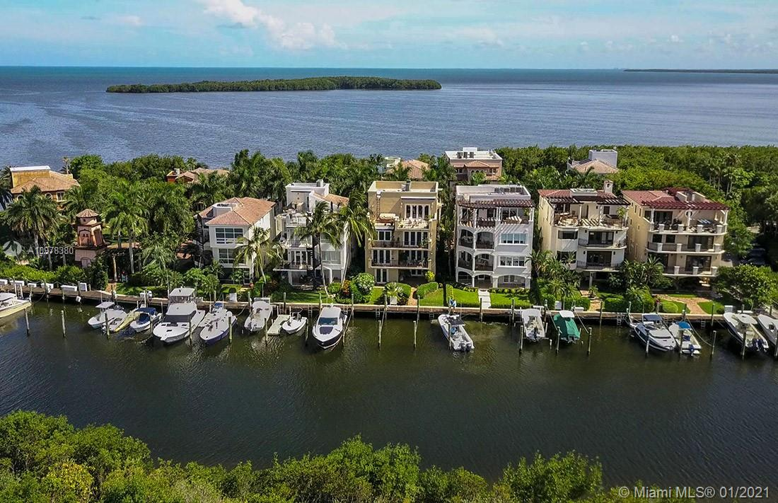 Spectacular Waterfront Single Family Home on Exclusive Royal Harbour Yacht Club at Paradise Point. Enjoy the Island Life with Extensive Amenities and 24 Hour Security. This 4 Story Masterpiece Features Private Elevator, Impact Doors and Windows, Rooftop Terrace with Amazing Views of Downtown Miami, Biscayne Bay & Key Biscayne. No Bridges to Bay, Includes Private Boat Slip. Formerly Owned by Famed Architect/Artist Brito. This Home has Many Fantastic Features and Space to Accommodate a Large Family and Entertain Friends. Golf Cart Community has Private Beach, Heated Pool and Jacuzzi, 2 Tennis/Basketball Courts, GYM, Clubhouse, Nature Trail and Marina.