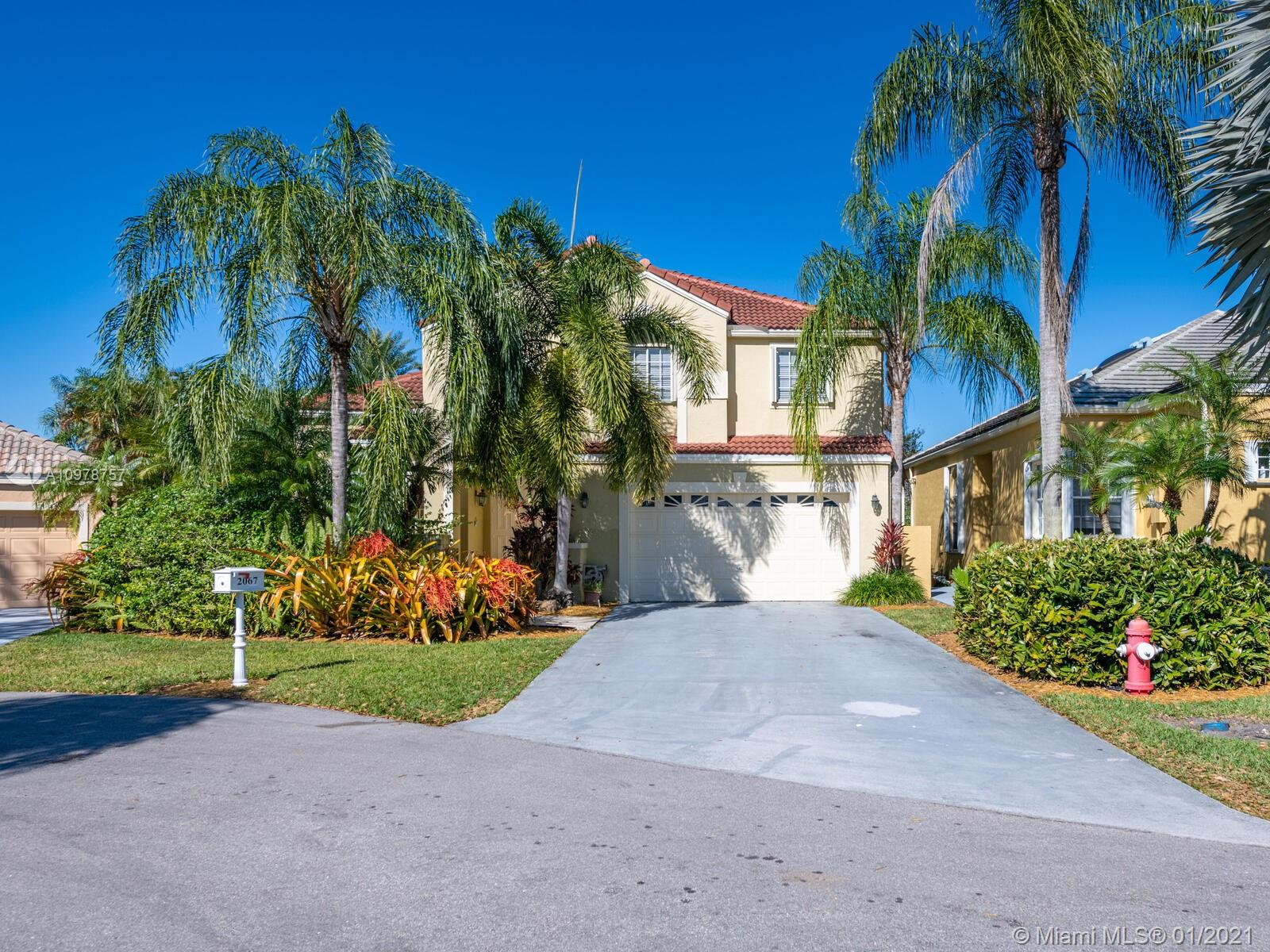 BRING your fussy BUYERS to this SPECTACULAR 2-story 4BR/3.5BA HOME in SOUGHT after SECURE gated community in Captiva Cay. Volume Ceilings, walk-in closets, skylights, Large UPDATED Master BA on ground floor and 2 ample size BR and 2 BA on the second floor, Over sized 2 car garage, numerous closets, separate laundry room, hurricane shutters and more. Updated kitchen w/ granite counter tops.  Closets have been updated too.  For all your entertaining, you have a large tiled screened in patio that looks out to a beautifully landscaped oasis of a yard. Lovely PRIVATE YARD has Room for a pool. Easy access to I-75 and walking distance from Weston Town Center.