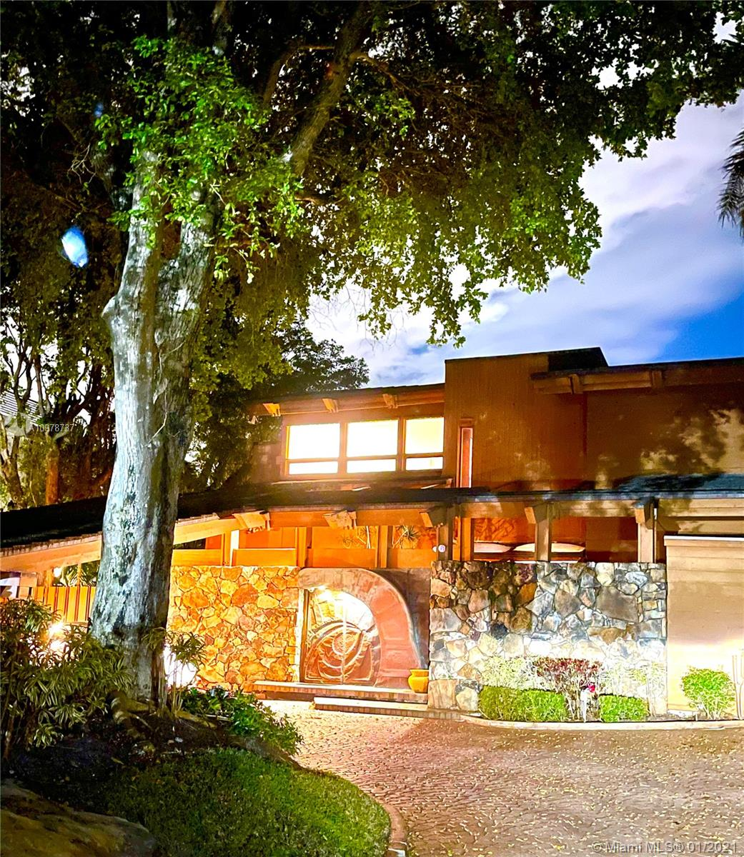 Prime sought after prestigious Bay Harbor Island estate on an amazing property! A Mid Century One of a kind California Style built in the late 1970s on a spacious lot of over 14,000 sf approximately 180 x 80 amazing wide bay view! Highest elevation seawall & 50ft dockage with elevator lift. Create your own masterpiece here....Renovate or build your dream estate...P Walking distance to the beach, and world famous Bal Harbour Shops, among  restaurants, Hotels and more all on Kane Concourse,  Also in Walking distance an A rated Ruth K Broad elementary school. Peace, privacy and tranquility.  Please contact the listing agent for more info.