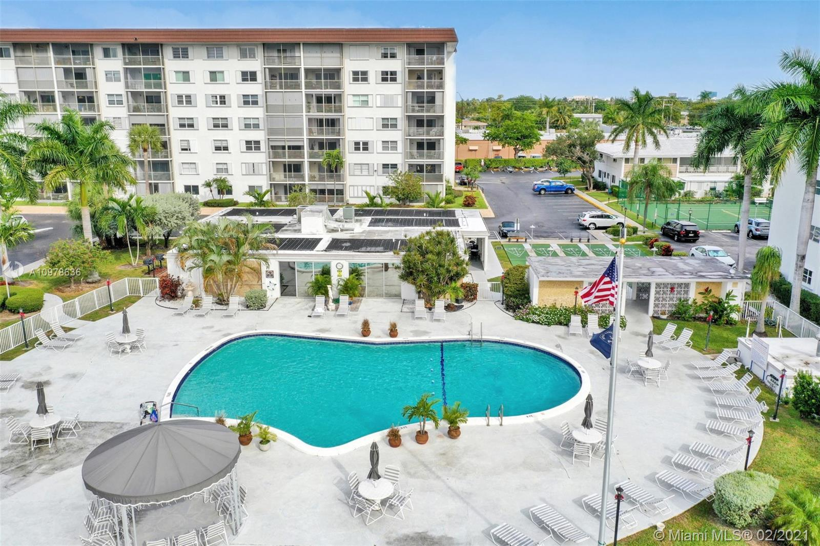 Perfect location between the entertainment districts of Wilton Manors and Oakland Park. This light filled condo is perfectly laid out for easy living with two bedrooms, two bath that include new floors throughout and a screened in porch with partial river view. The grounds are perfectly landscaped and include tennis and shuffleboard courts, a large pool with clubhouse that includes exercise room and sauna. Leave your door and be at the beach in 10 minutes. Direct TV and internet included in HOA. Ok to lease first year!