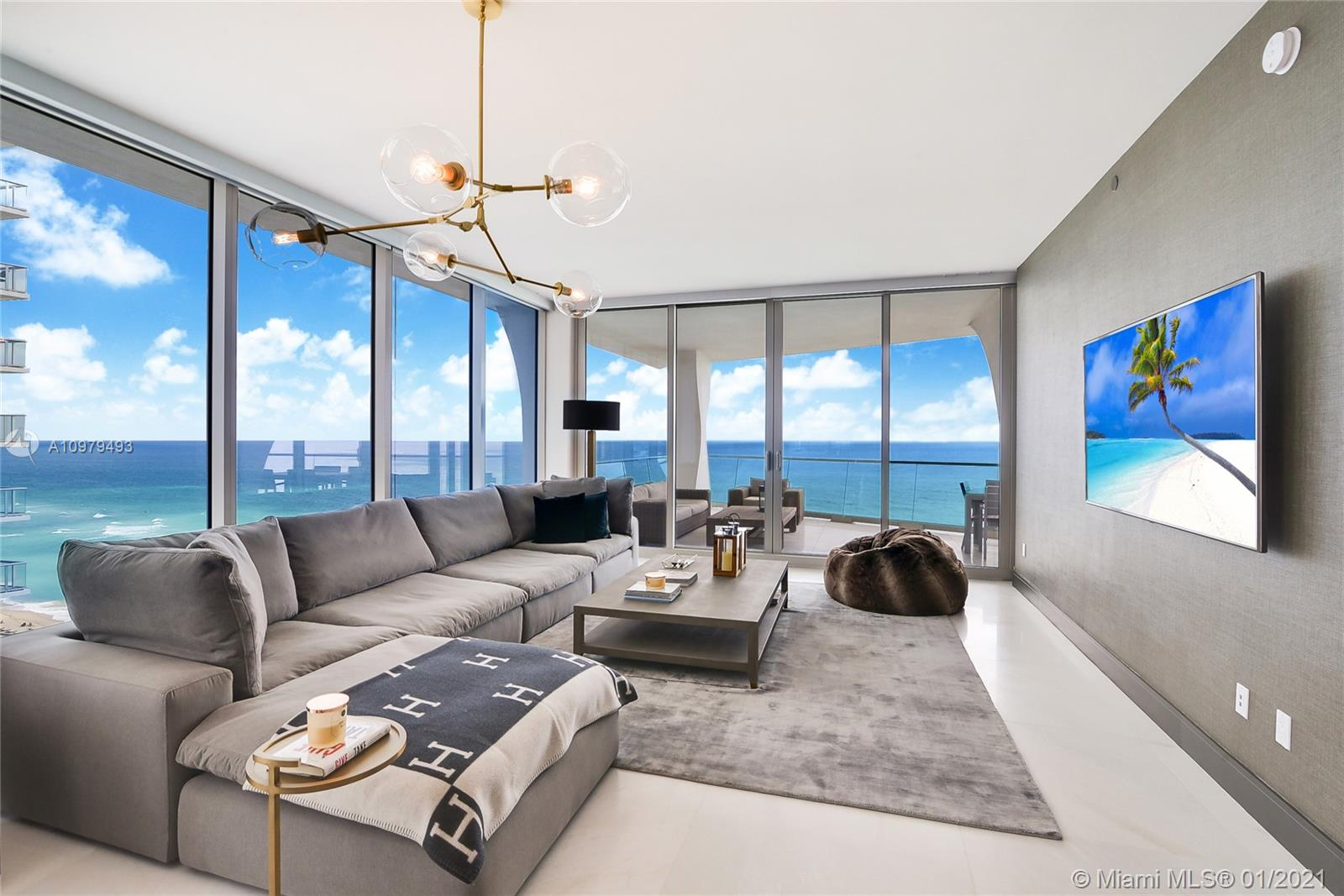 Spectacular Oceanfront residence with breathtaking, unobstructed views of the Atlantic Ocean. Immaculate 4 bedrooms, 5 & 1/2 bathrooms flow through residence with 2 assigned parking spaces, Private elevator and 3,465 sf under AC plus 881 sf of outdoor terraces. It features marble flooring, high end appliances .Enjoy the Jade Signature luxury lifestyle and all the exclusive amenities at this magnificent Residence. Professionally decorated, fully equipped and tastefully designed turn key unit.