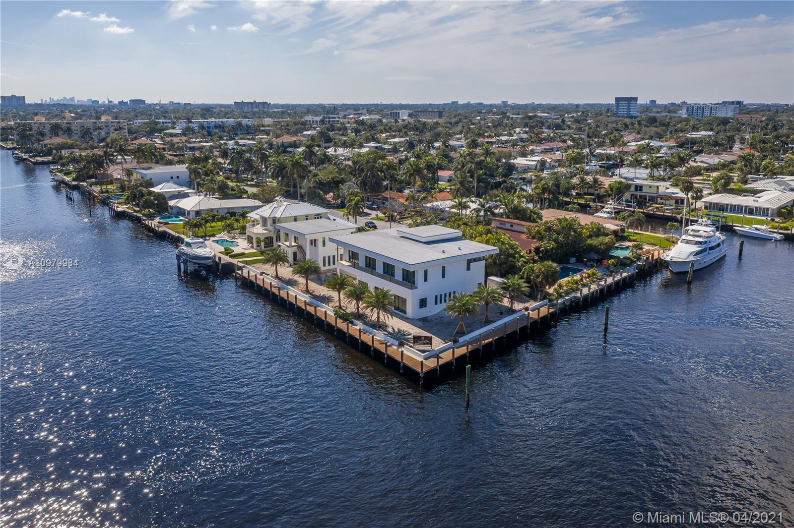 Another Luxurious Brand New Construction Estate Designed By Karam Brothers. This magnificent point lot estate is conveniently situated on one of the wider canals in the area and only minutes to Hillsboro inlet. ULTIMATE Yachter's dream with 267 feet of water frontage offering breathtaking views and all the benefits of waterfront living. The contemporary architecture and layout design offer a stunning main house featuring top-of-the-line upgrades and finishing touches and a separate carriage house perfect for your guests, captain or private gym. Call today for details and to schedule your private tour.