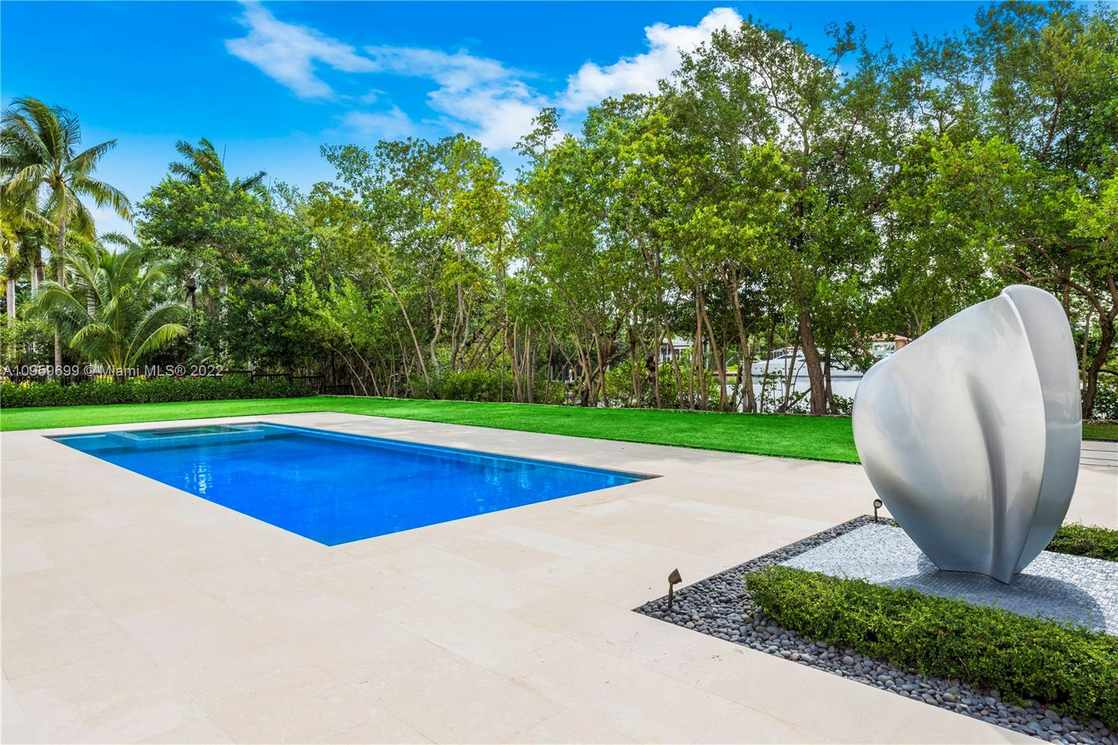 2021 Masterpiece located in one of only two private & gated Coral Gables communities. Set on almost 2 acres w 200' of water & direct ocean access, this magnificent estate has been meticulously designed for the most discerning Buyer. Spectacular soaring entry leads to six beds & 7 baths spread over 12,829 SqFt of la. Chef's kitchen is an epicurean dream w gourmet kitchen featuring gas cook-top, cooking island, food warmer, double ovens & a large window overlooking  pool & waterway. Covered terraces, 2nd story terraces and expansive pool area featuring a fully equipped outdoor kitchen & dining area w BBQ grill.Gym, indoor rock climbing wall, wine cellar, full home generator & 9car garage (w height for lifts) are some of the luxuries which make this estate one of a kind. (Adj SqFt 13,212)