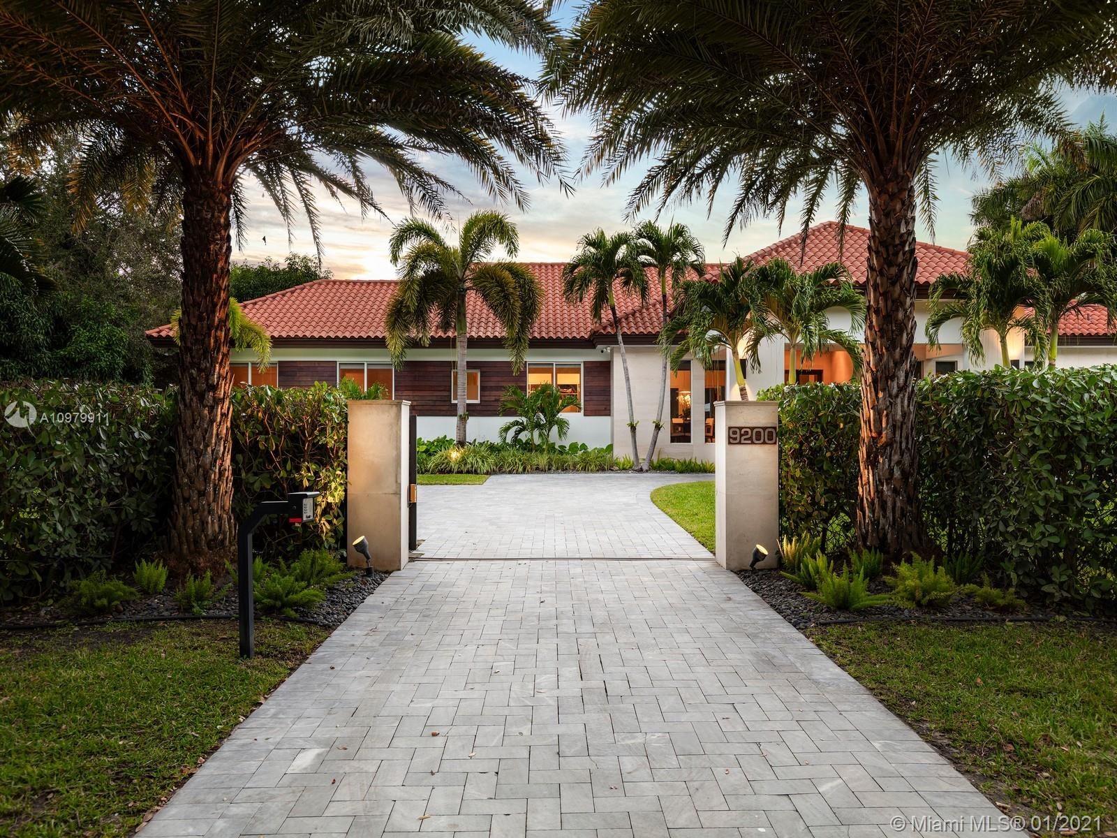 Impeccably pristine estate located in N Pinecrest, nestled on a 33,976 sf gated lot, surrounded by manicured landscaping. This estate has been completely renovated w/ fine finishes & high ceilings throughout. Welcomed by a spacious open floor plan w/ an elegant living rm, dining, breakfast area & numerous imp windows & doors providing fascinating views. This 6-bedrm, 5-bathrm residence boasts expansive living areas incl two family rms, media rm, & open concept kitchen w/ top-of-the-line appl, wet bar & wine gallery. Master suite offers a spacious setting w/ spa bath, walk-in closet & access to patio area. Discover an outdr oasis w/ covered patio, lounging area, summer kit, & large swimming pool. Additional Features: 2 Car gar, service quarters, mango fruit trees. Pinecrest Elite Schools.