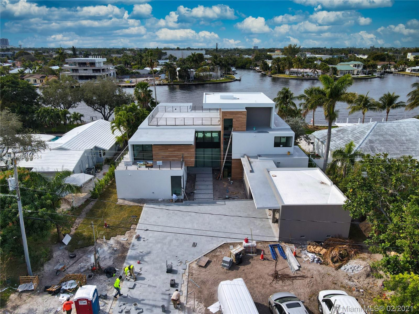 Unique, stunning, modern estate. 100 ft water frontage with panoramic views and dock. Infinity pool with attached spa. This amazing waterfront residence built in the established Coral Ridge neighborhood at 1529 Middle River Drive, Fort Lauderdale, Florida. The new home, designed in a contemporary style architecture, will be a 3-story structure with 7,700 square feet of living space that will include six bedrooms with a detached, 3-car garage, swimming pool, rooftop terrace and elevator.