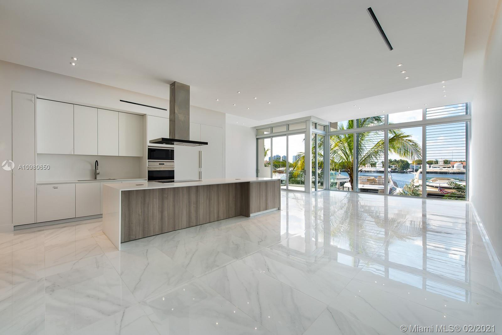 """New construction waterfront modern marvel. These new residences are to be complete this month! This """"Mallorca"""" model boasts over 3,585 SF interior with a private elevator, staff quarters, den or 4th bedroom, overlooking a tranquil marina and 90' yachts - slips available 40-120'. Located at The Point in Aventura, this waterfront residence will be delivered finished with custom ceilings, porcelain flooring and other fine finishes by Interiors by Steven G. Featuring modern Italian kitchens and bathroom cabinets by Mia Cucina, including top-of-the-line Subzero and Wolf appliances. Dramatic 12-foot ceiling heights in living room, dining room & kitchens areas. Owners will enjoy a 25,000 SF state-of-the-art fitness center & full-service spa, fitness center, spa café, and lighted tennis courts."""