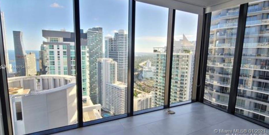 Amazing 44th floor Southwest corner unit at prestigious 1010 Brickell. One of the largest units in the building, featuring a large balcony with unobstructed Biscayne Bay, Coconut Grove and city views. Unit features, 2 bedrooms with an extra large den which can be used as a third bedroom and 3 full bathrooms. European design kitchen with high end appliances. Italian ceramic tiles through out with built in closets and window treatments in every room. Magnificent night day and night views from the master bedroom with wraparound floor to ceiling glass windows. A must see.