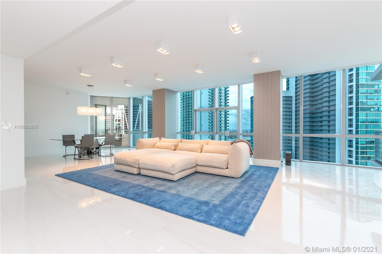 JUST REDUCED $300K! Unique and spacious combination residence on the upper floors with magnificent views of the bay, ocean and skyline. Professionally designed by Interiors by Steven G, this plush residence boasts nearly 3100sf of interior space plus 2 large terraces, double master bedroom, oversized den that easily converts to a third bedroom, leaving a generously sized den in addition. Design features include 31x70 Italian porcelain flooring, custom kitchen with Geoluxe tops, automated window shades with blackouts, custom built-in's, Polyform wardrobes, custom bar area with wine storage, contemporary light fixtures, custom millwork and more. Sonos audio and luxury furnishings can be included. 2 deeded/self-parking or valet spaces. Building features 3 swimming pools, tennis and soccer.
