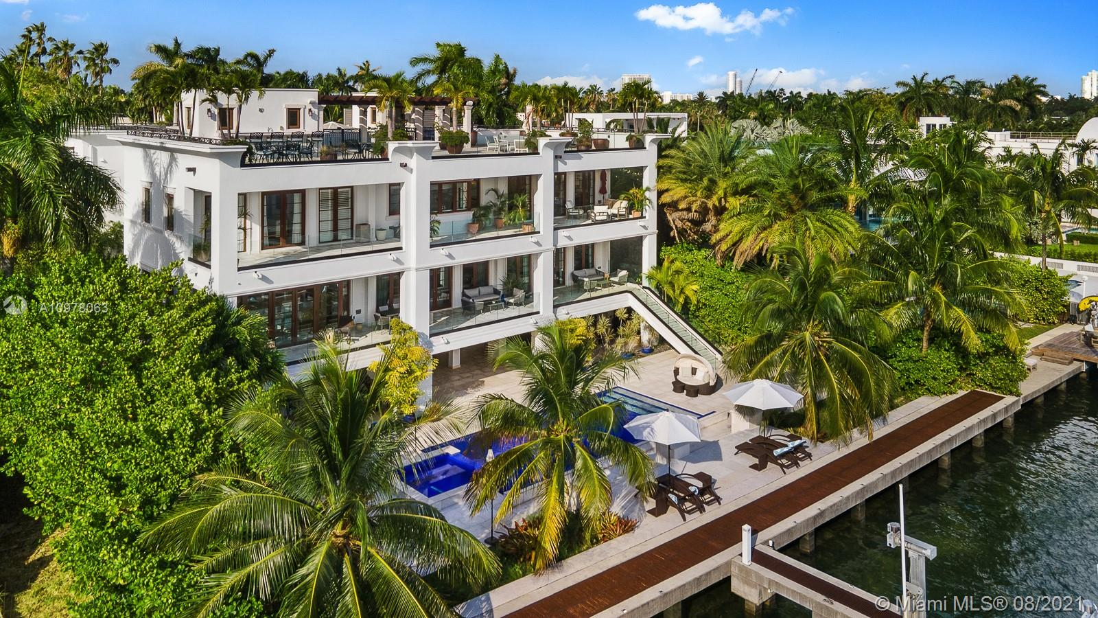 Enjoy Miami's best views from this distinguished 3-story, waterfront estate on exclusive, guard gated Palm Island. It's 5000+ SF rooftop w/ unique 360-degree visibility boasts unobstructed views of the spectacular city skyline, passing cruise ships & the coveted city sunset views visible not just from its rooftop, but also from its master suite, kitchen, pool deck & many other entertainment areas. Conceived for both indoor & outdoor enjoyment w/ 9 bedrooms/10.5 baths, indoor movie theater, gym, game room, large ground floor entertainment area, smart house systems, & elevator for easy access to all floors. This gated home offers a 4 garages plus space for 6 more cars in the driveway. The home's private dock can accommodate boats up to 100ft and has a center console lift & a floating dock.
