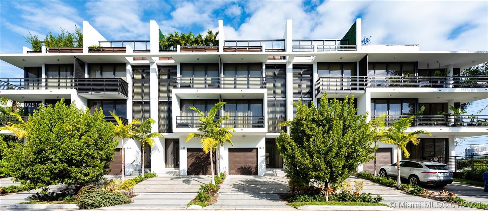 Modern townhome with it's own private rooftop pool. Designed using clean lines & incorporating